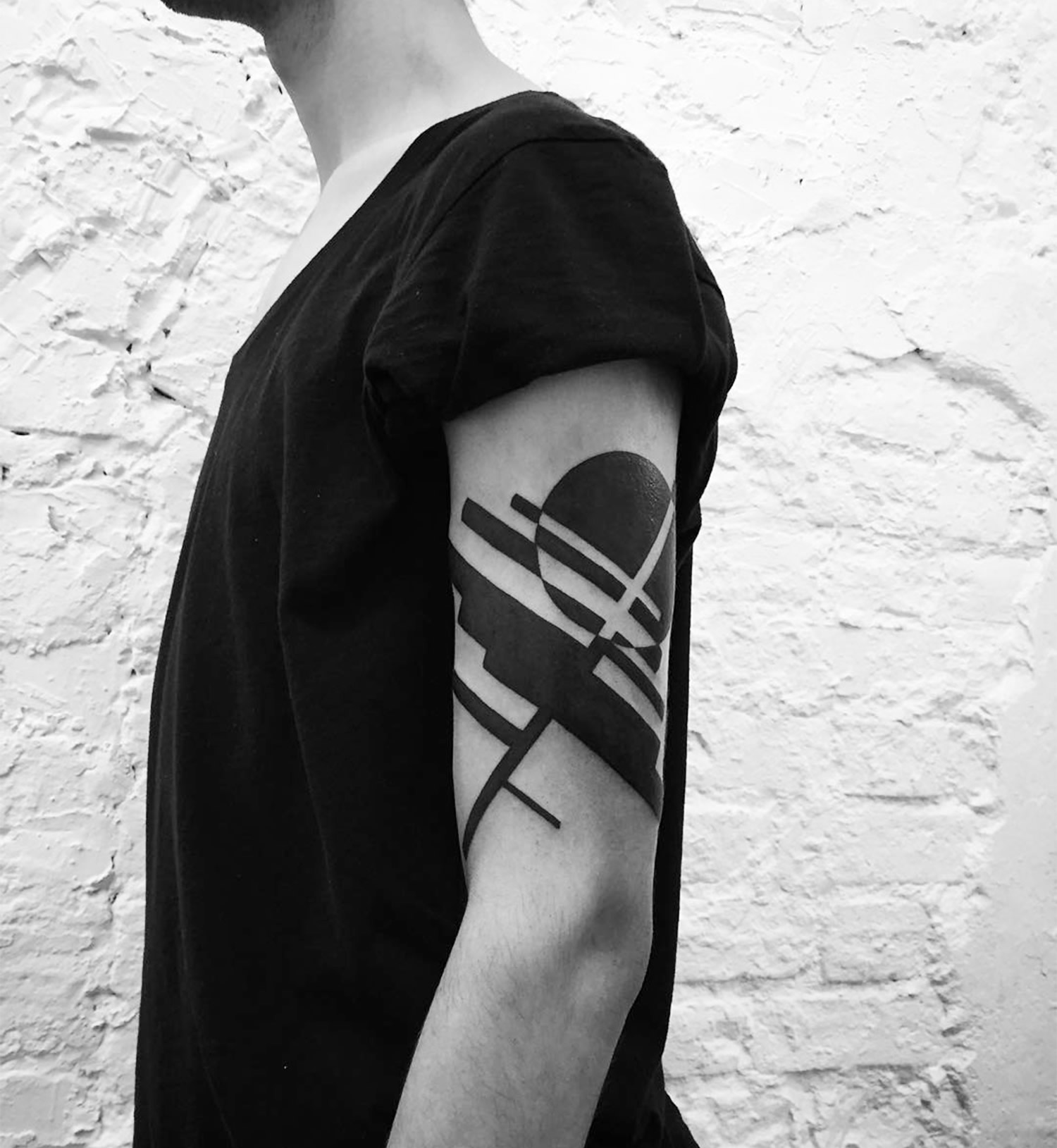 abstract black ink tattoo on arm