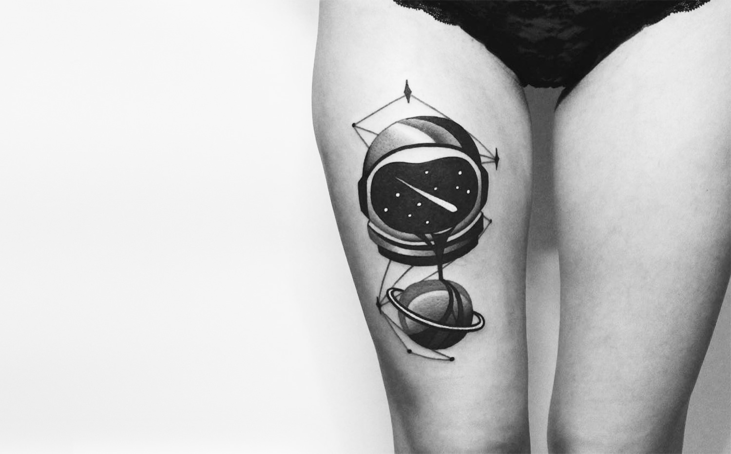 astronaut tattoo on leg