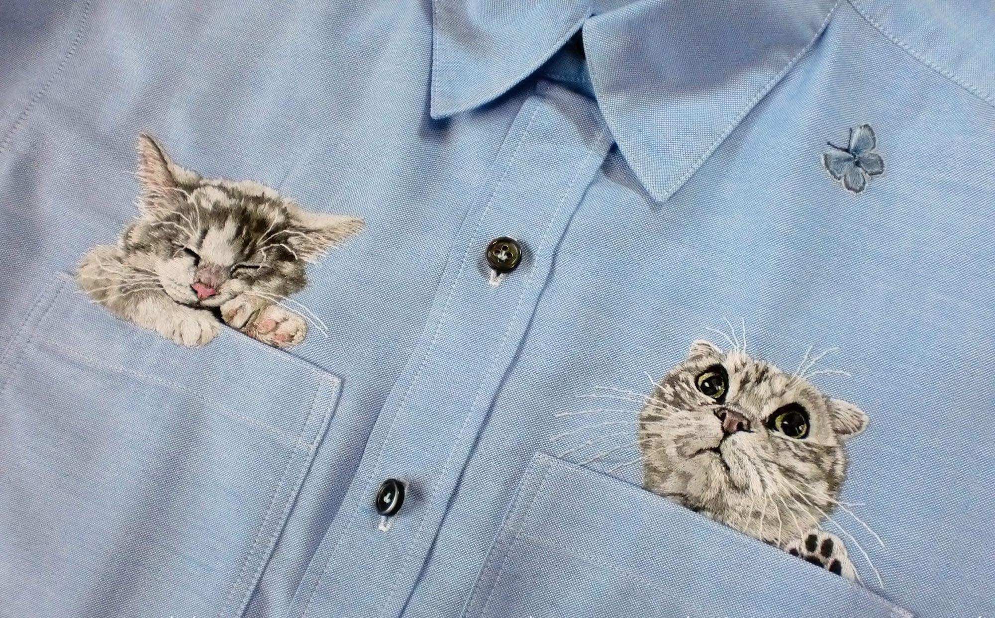 embroidered cats peeking out of shirt pockets by Hiroko Kubota