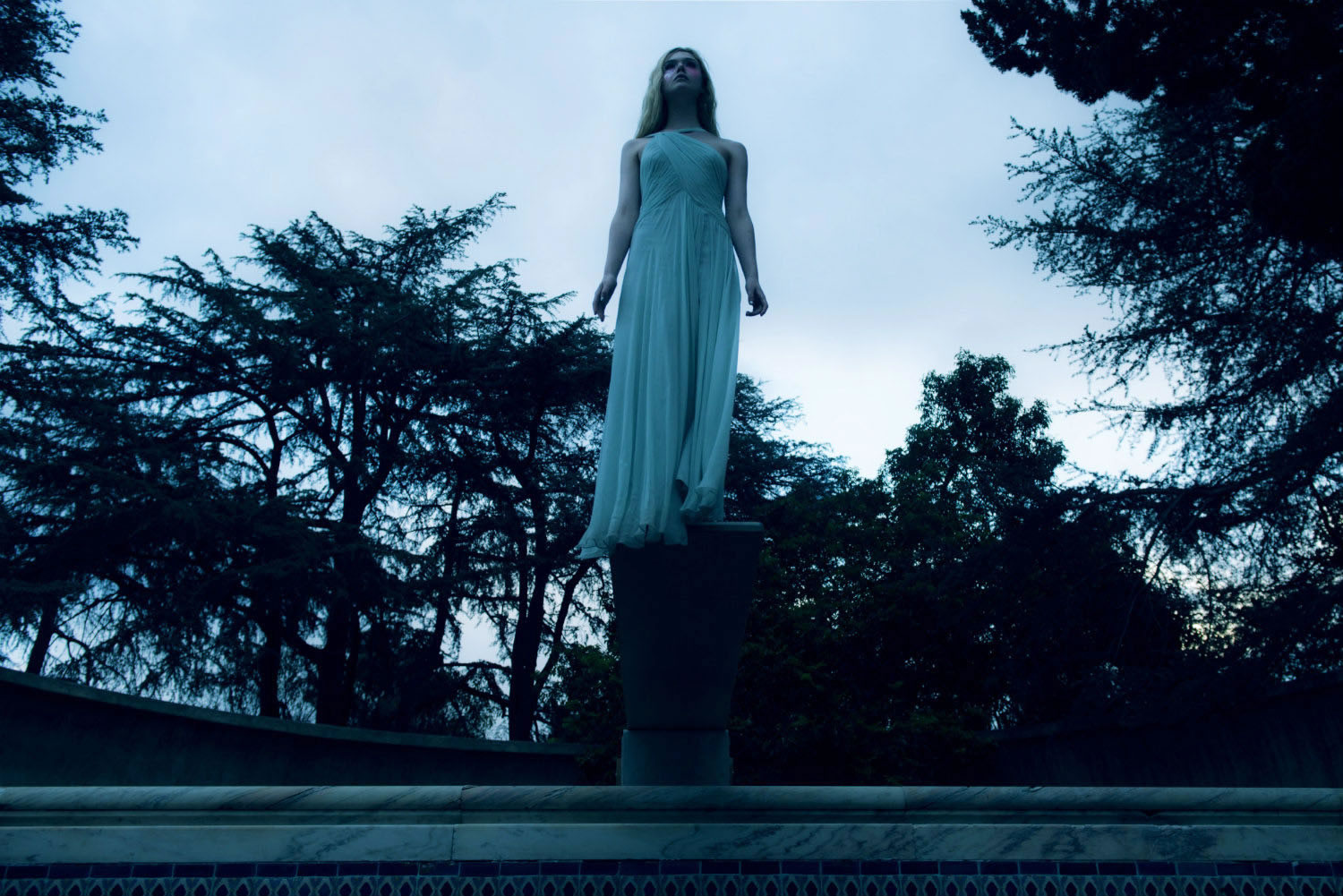elle fanning in white dress, blue lighting