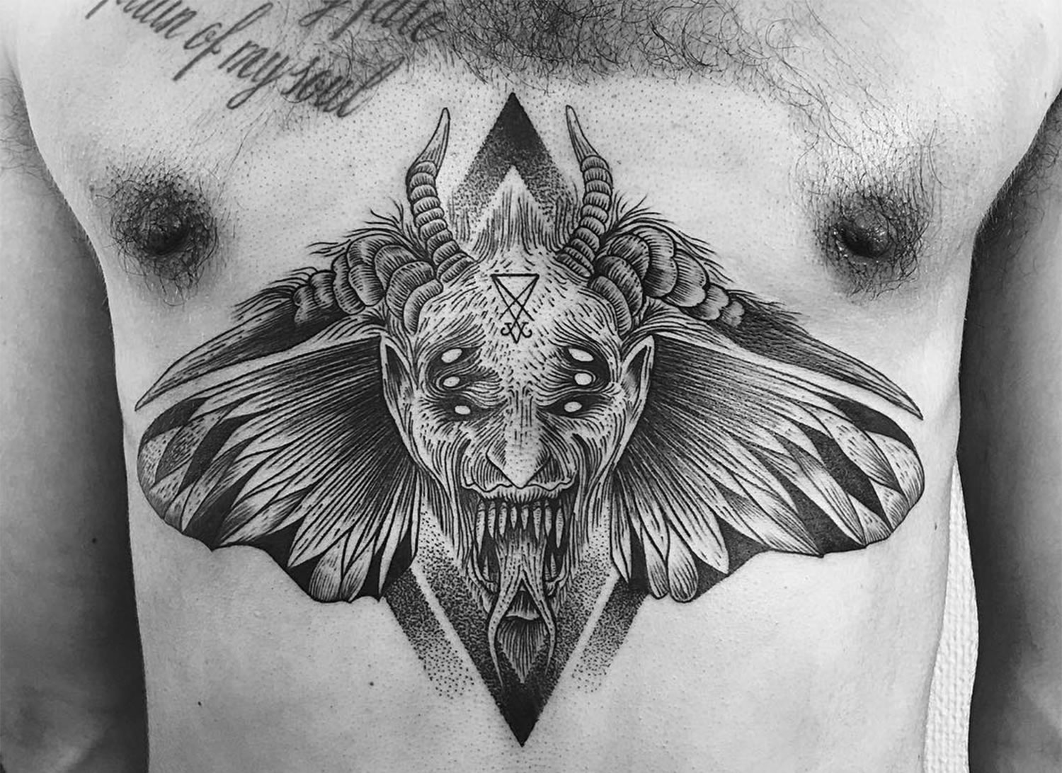 devil moth tattoo on chest