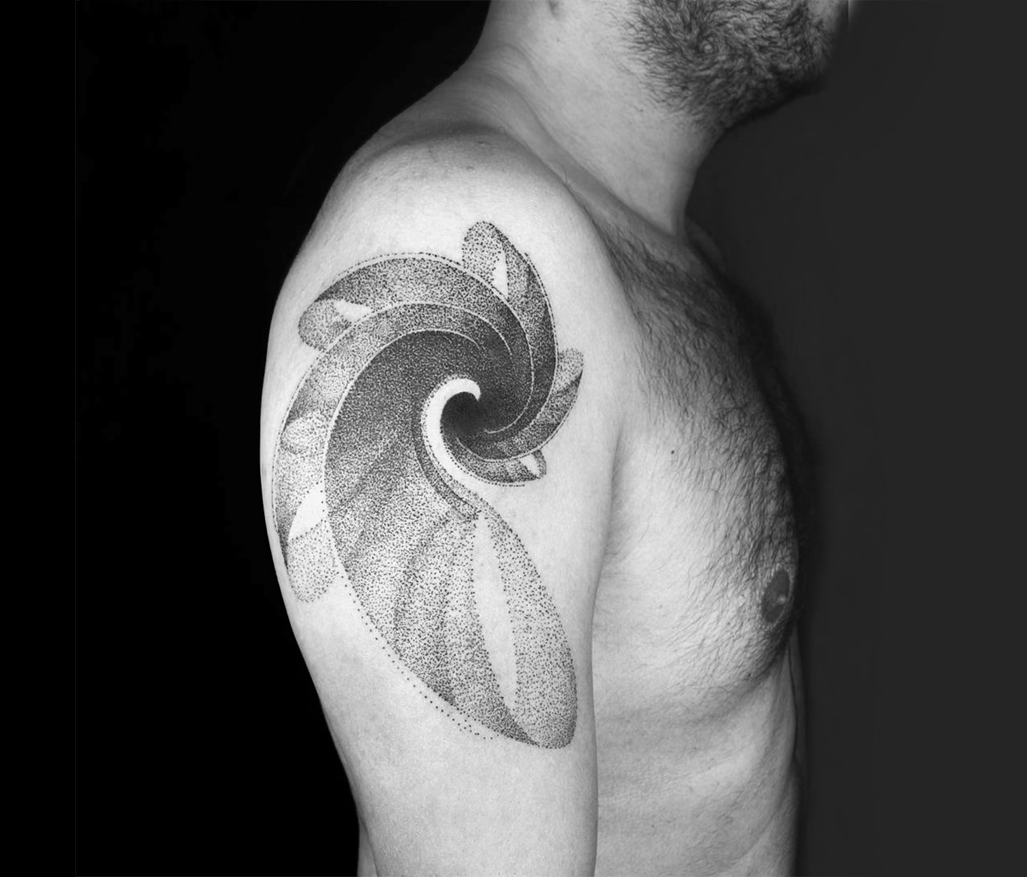 wave in motion, tattoo on arm by okan uckun