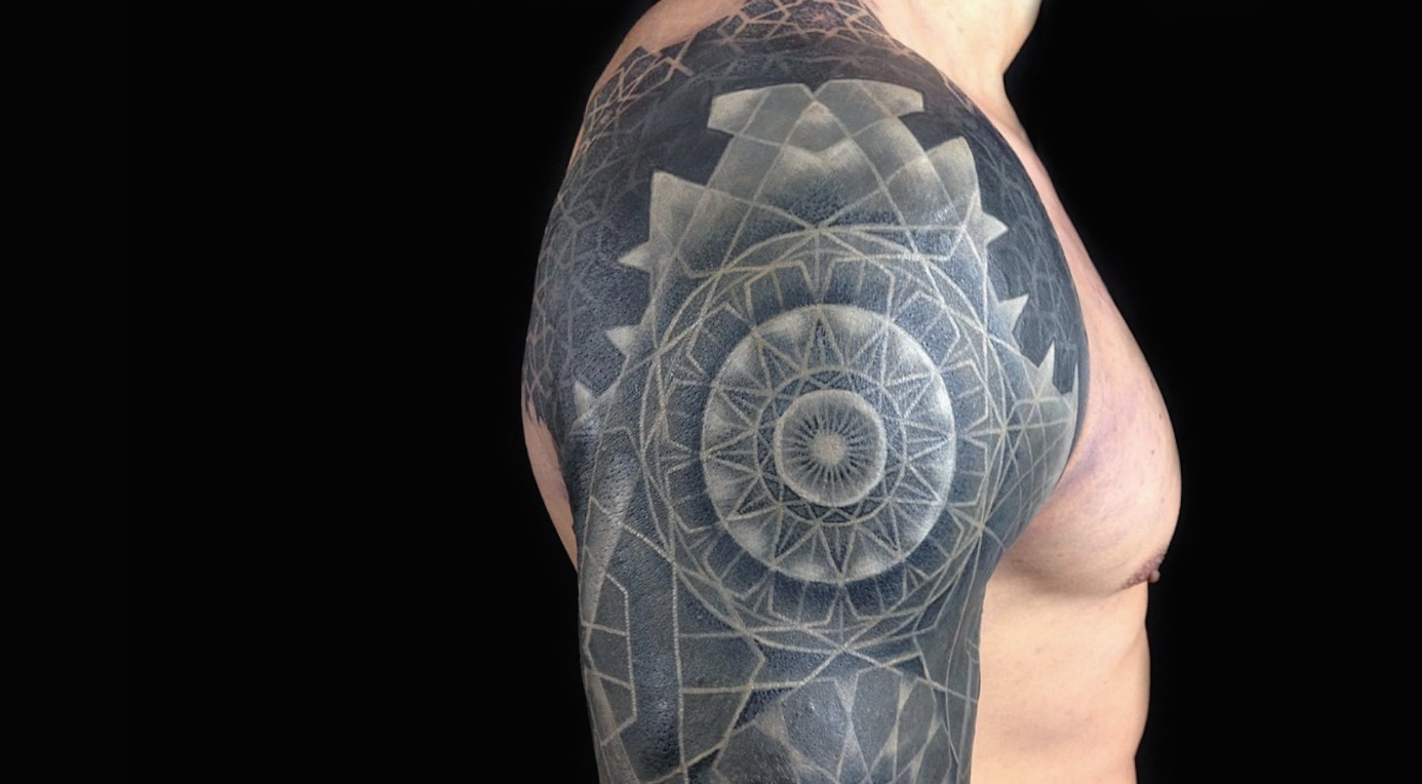 white on black ink tattoo
