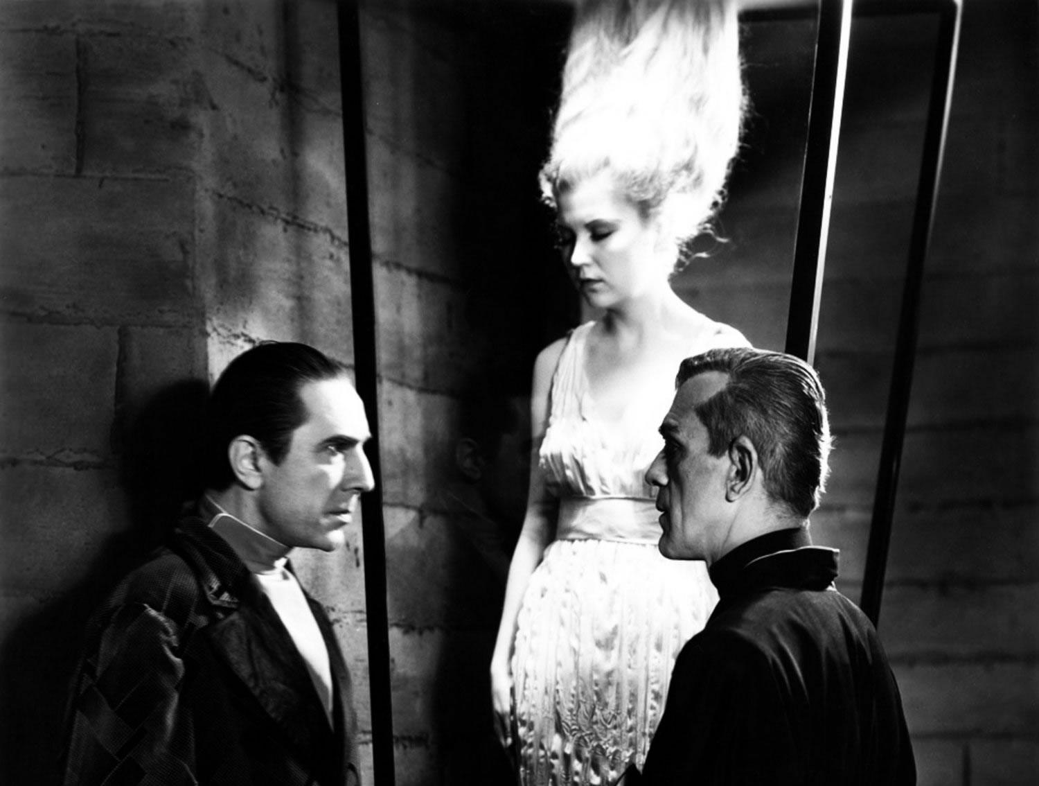 woman with frizzy blonde hair, and two men in the black cat (1934)