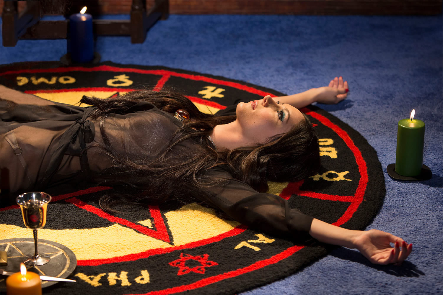 woman lying on floor, the love witch