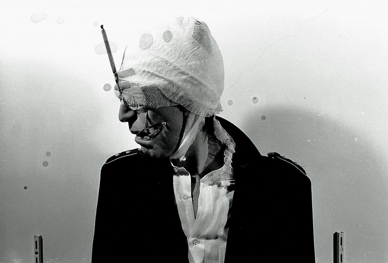 Gottfried Helnwein - Self-portraits and performances in Vienna, bandaged face, profile shot