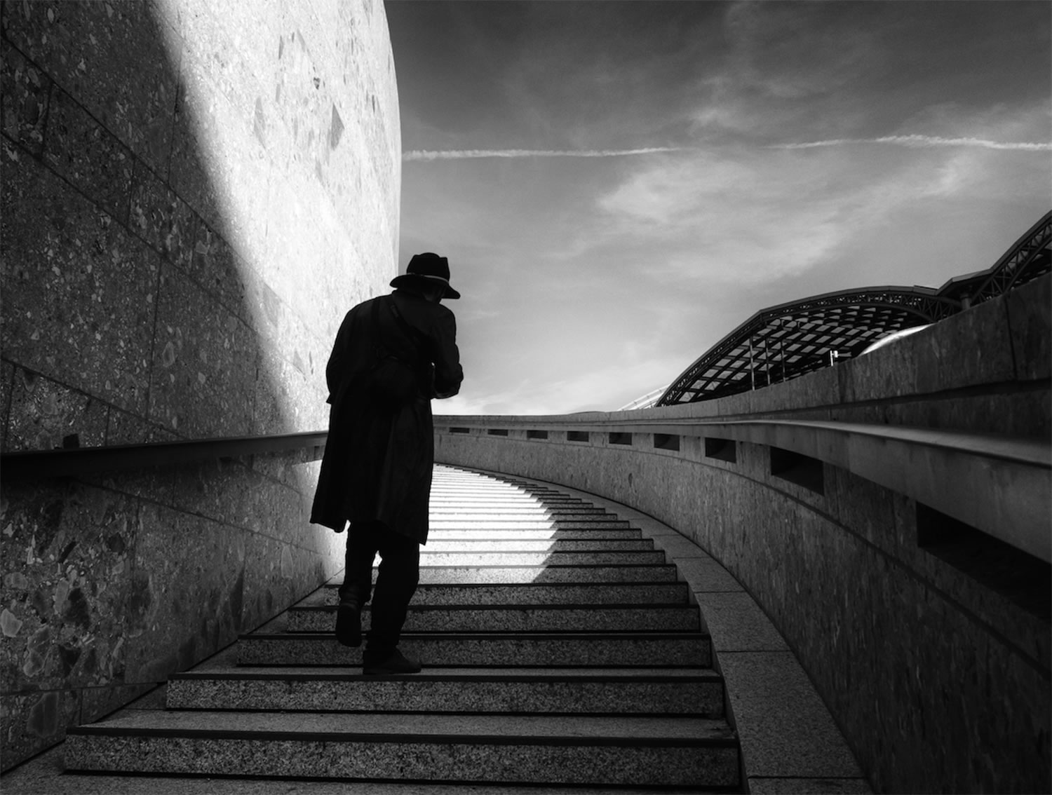 mysterious man on walking up stairs, black and white, by Georgie Pauwels