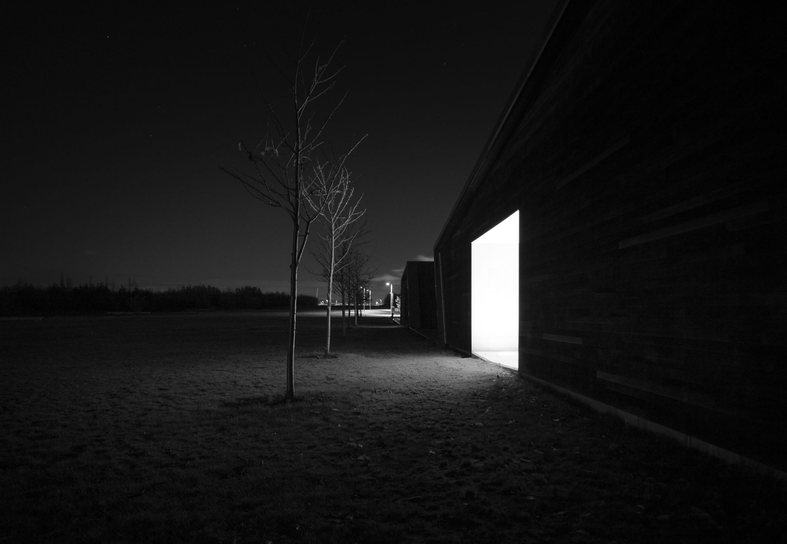 square, light coming from door, pitch black photo by Svein Nodrum
