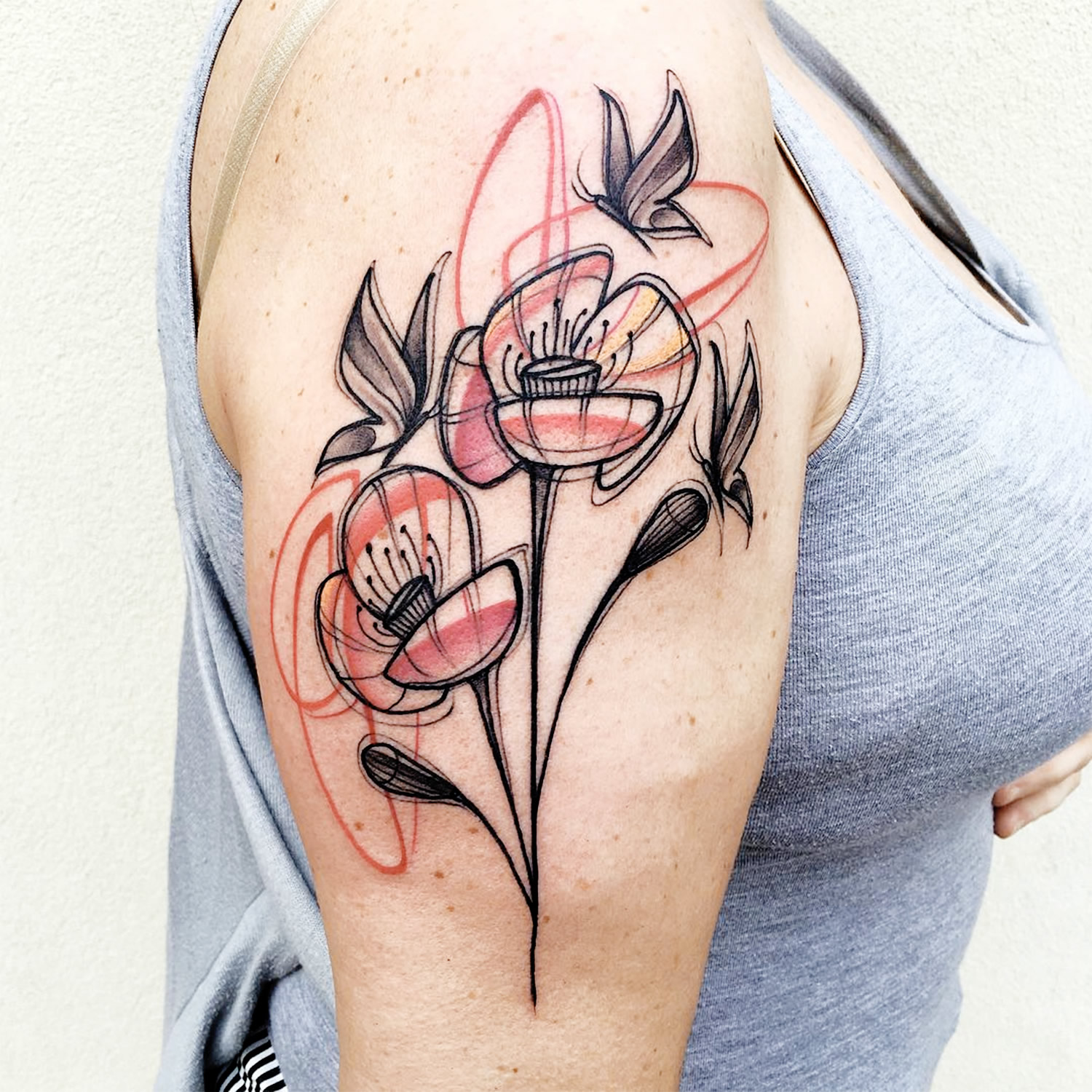 sketch style flower tattoo on arm