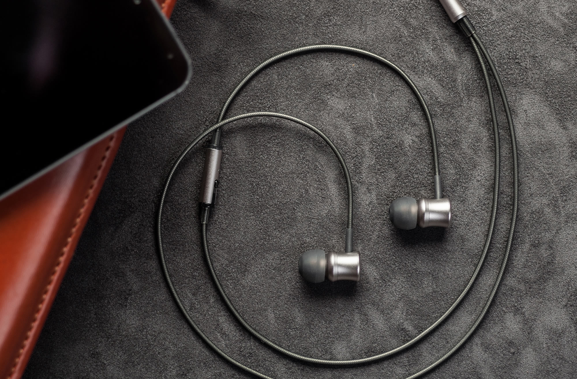 Meze 11 Neo Iridium earphones on grey carpeting