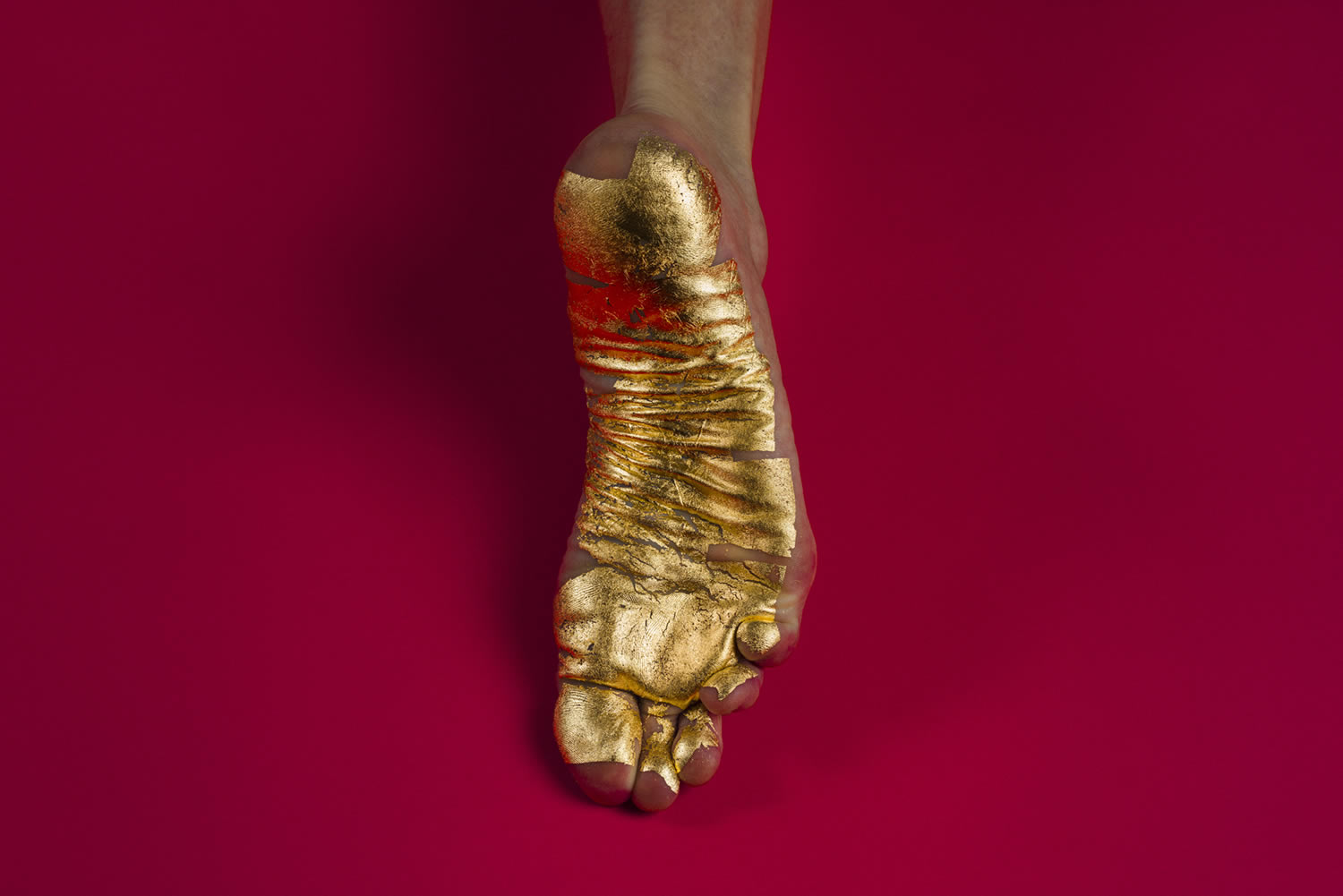 gold painted foot, photography