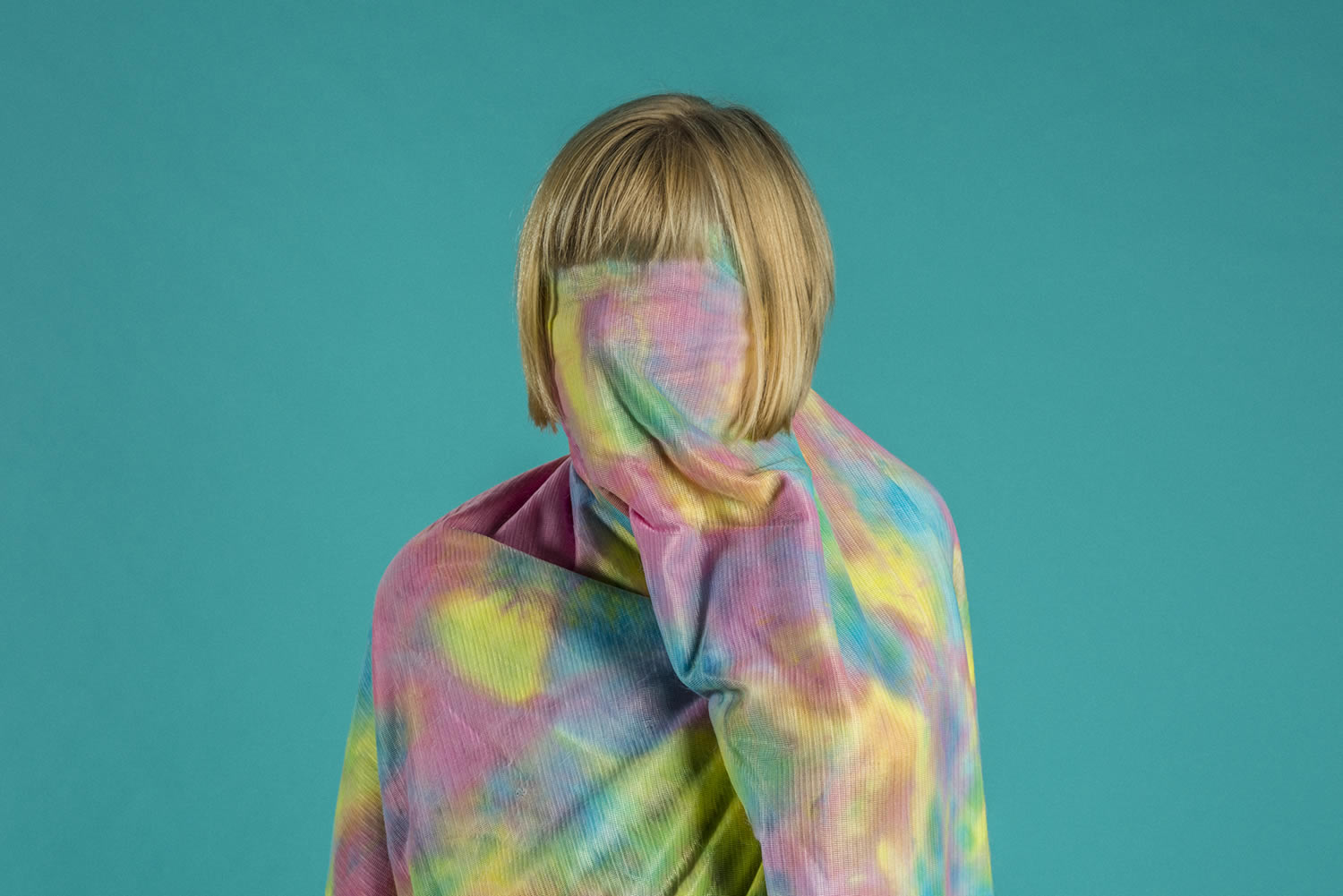 pastel camouflage cloth over human body