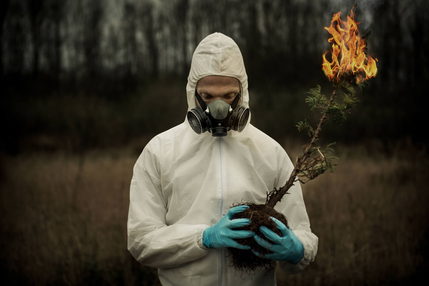 sourearth, man in hazmat suit holding a burning tree