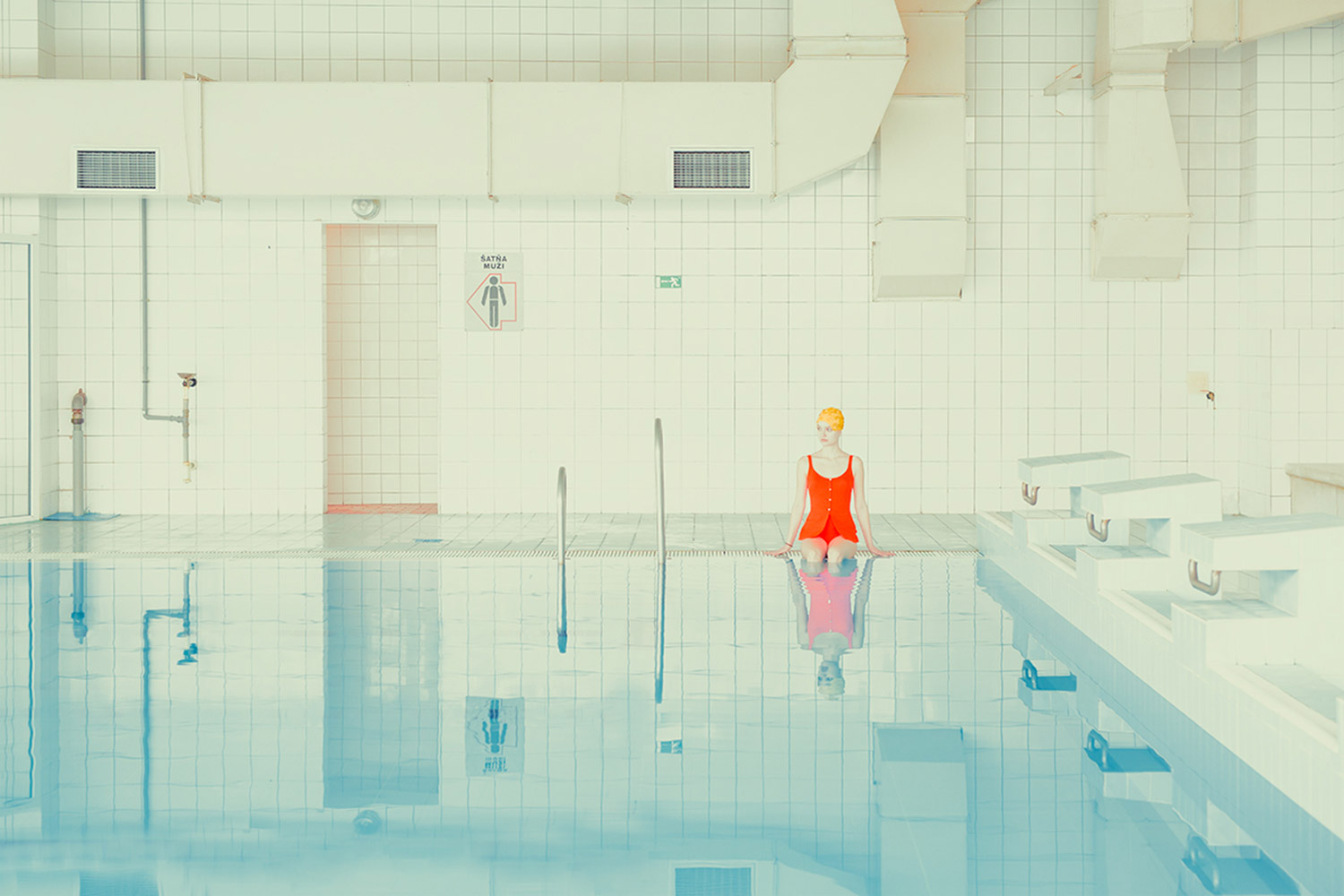 Maria Svarbova - Swimming Pool, sitting alone
