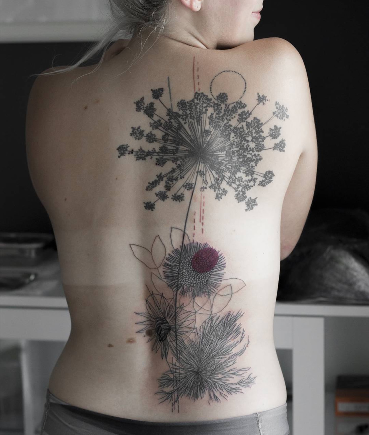 sketchy flower tattoo on back