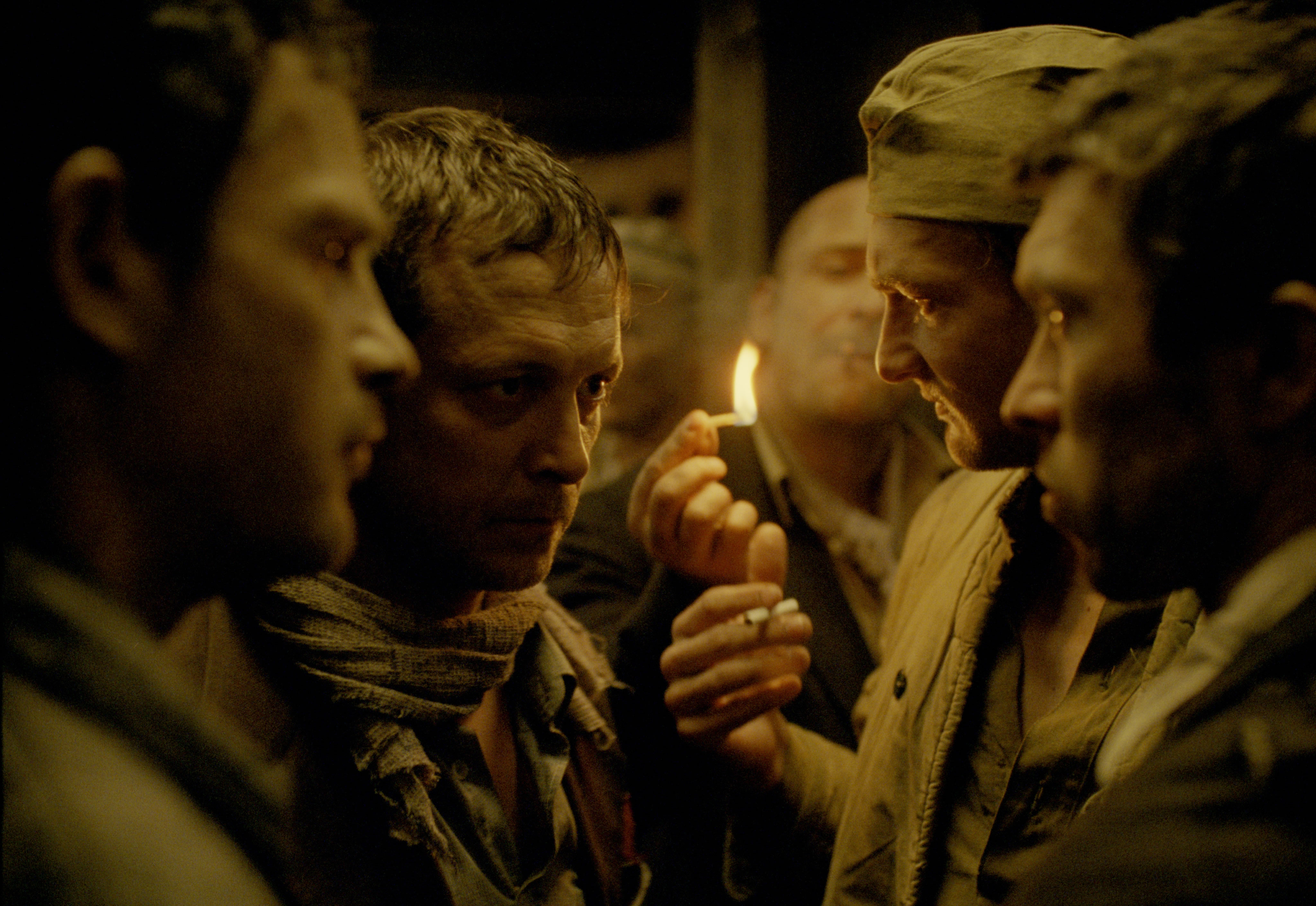 turning on lighter, men in confined space, son of saul