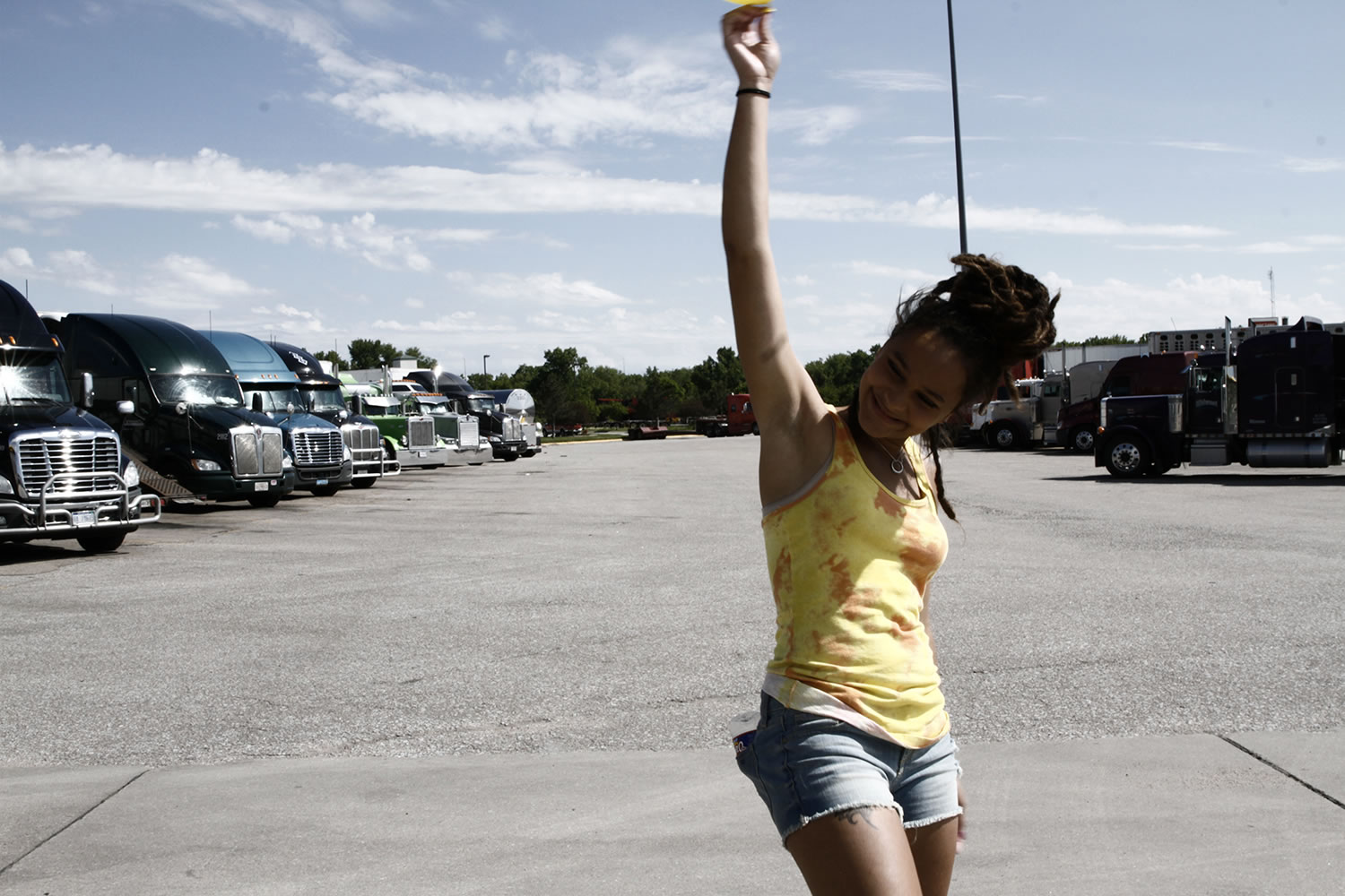 girl with hand in air, truck stop, american honey