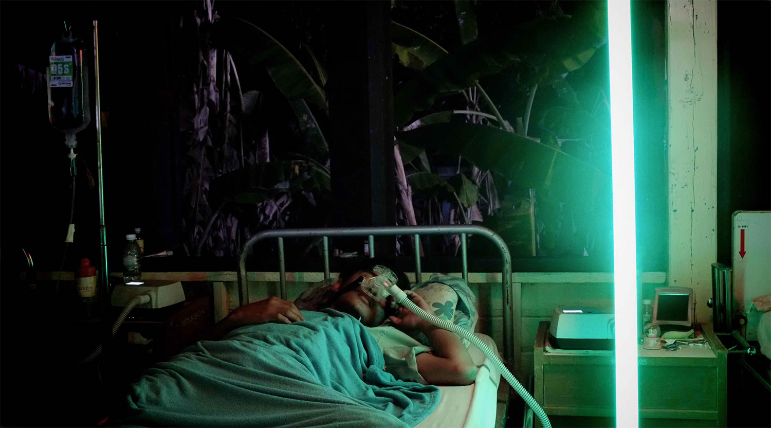 patient in sick bed, neon lights in cemetery of splendour