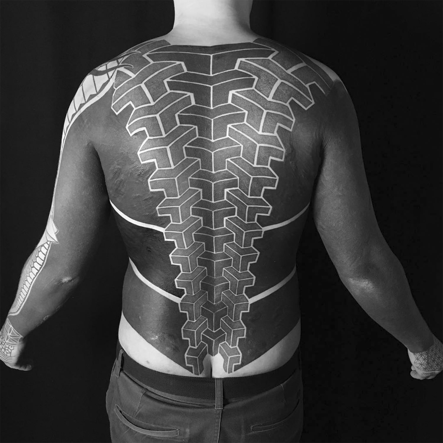 3d geometric shapes, black ink tattoo on back by gerhard wiesbeck