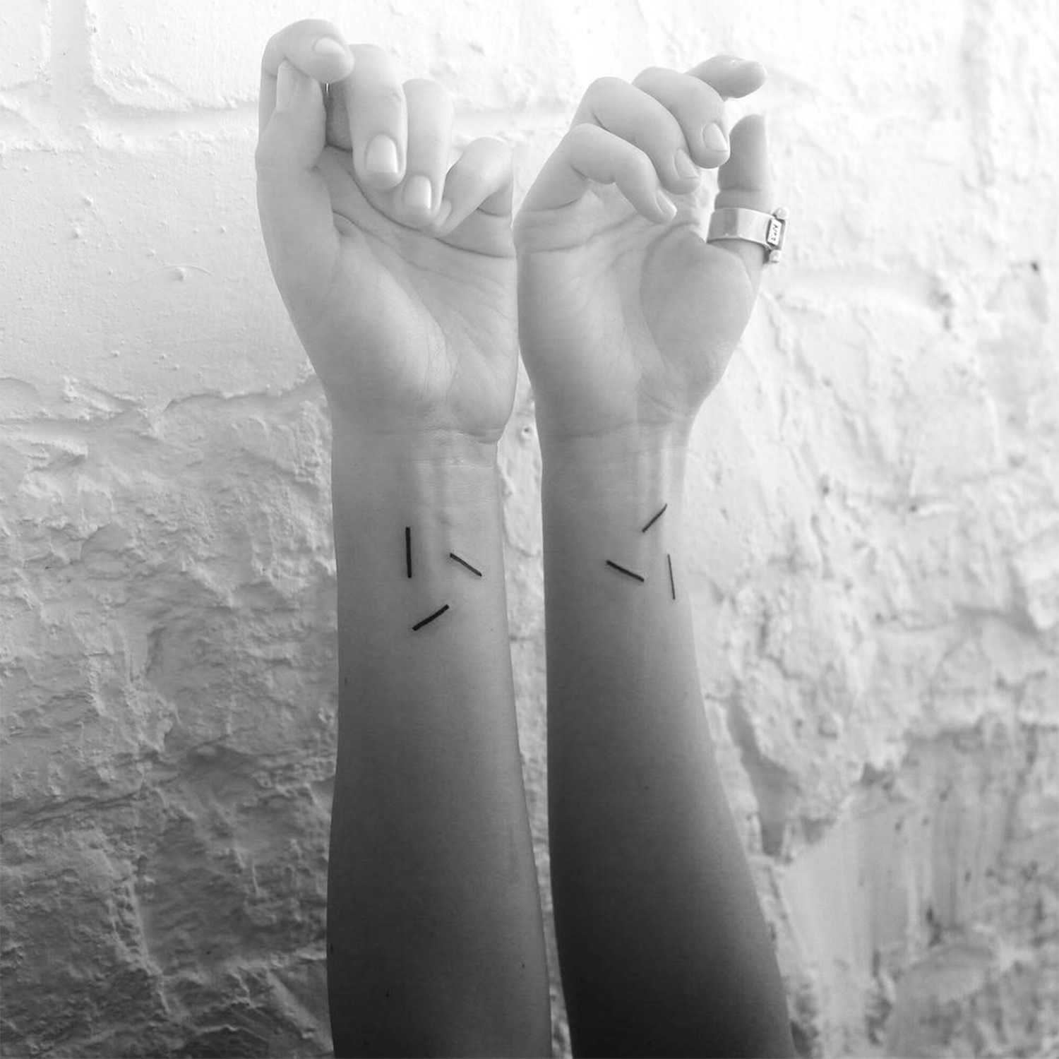 line tattoos on wrists by Stanislaw Wilczynski