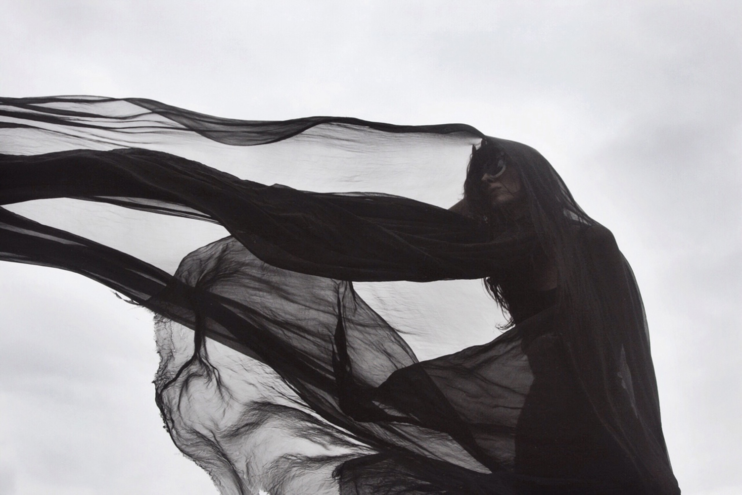 Nona Limmen - black veil with outstretched arm