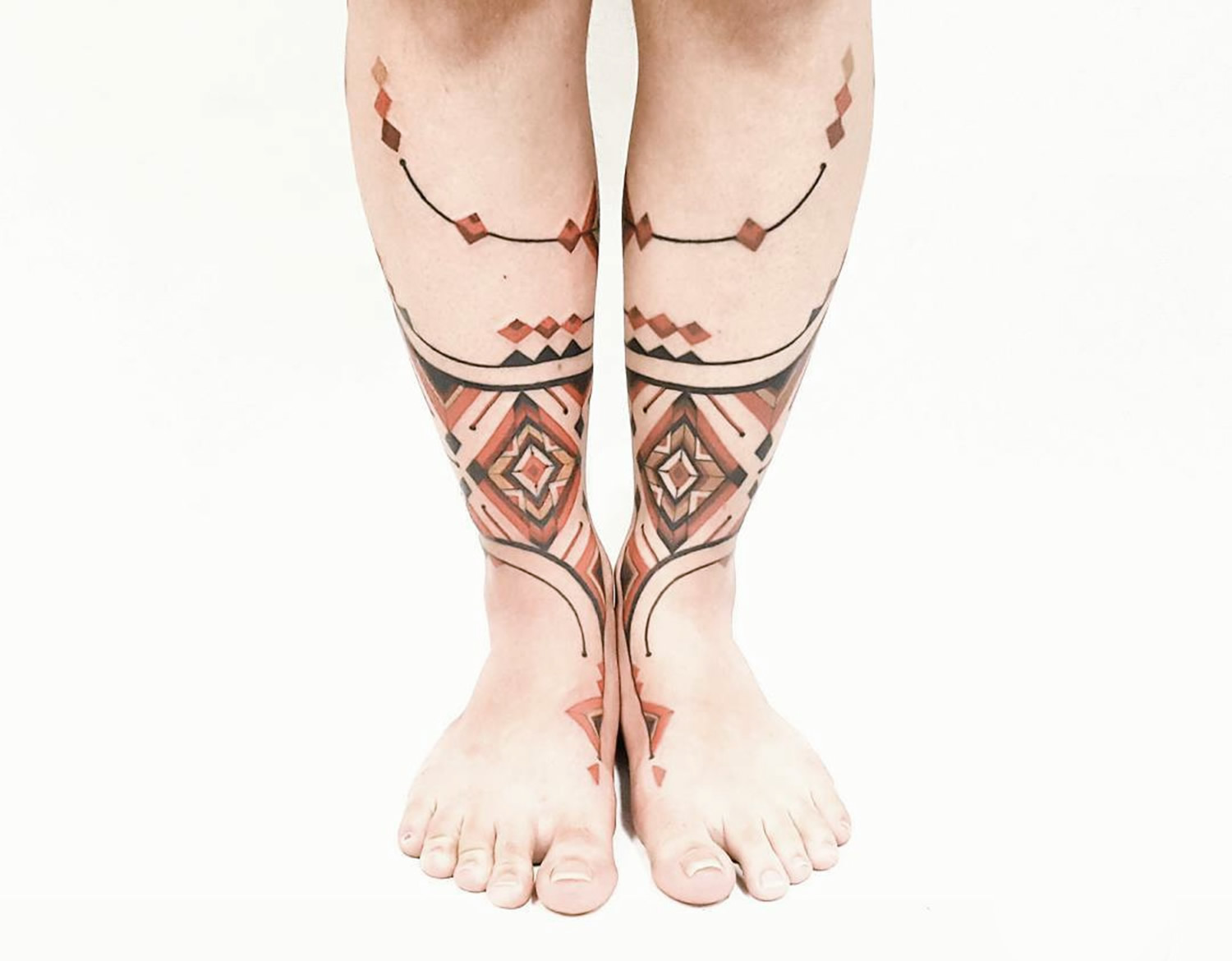 Brian Gomes double calf tribal tattoo
