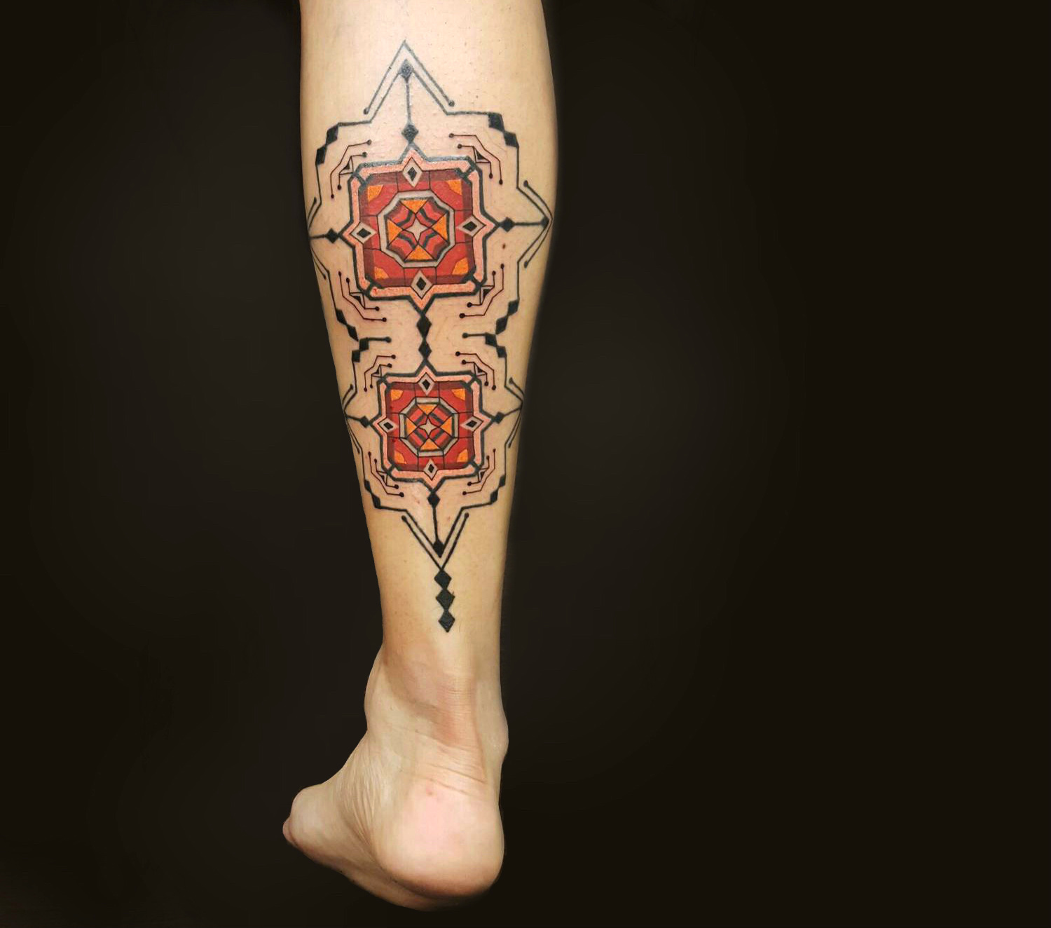 Brian Gomes red geometric tattoo