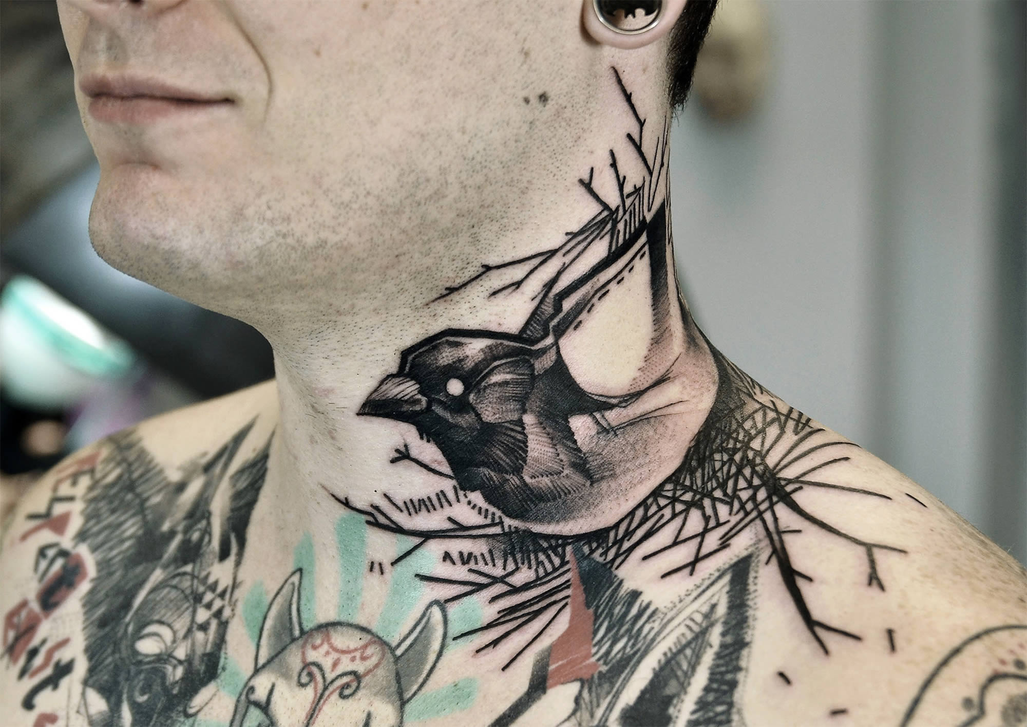 bird tattoo on neck