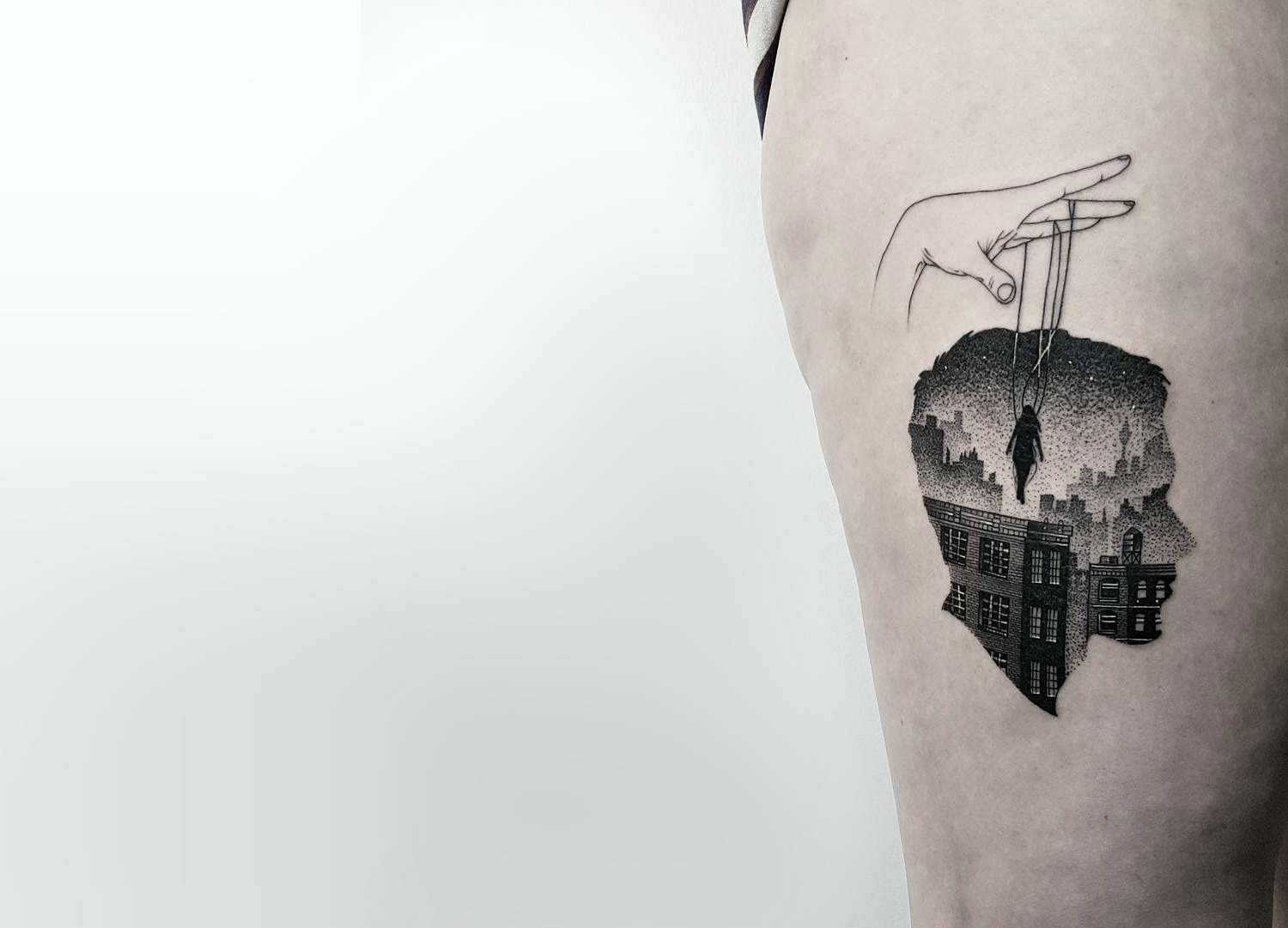 Double exposure blackwork silhouette tattoo by Matteo Nangeroni