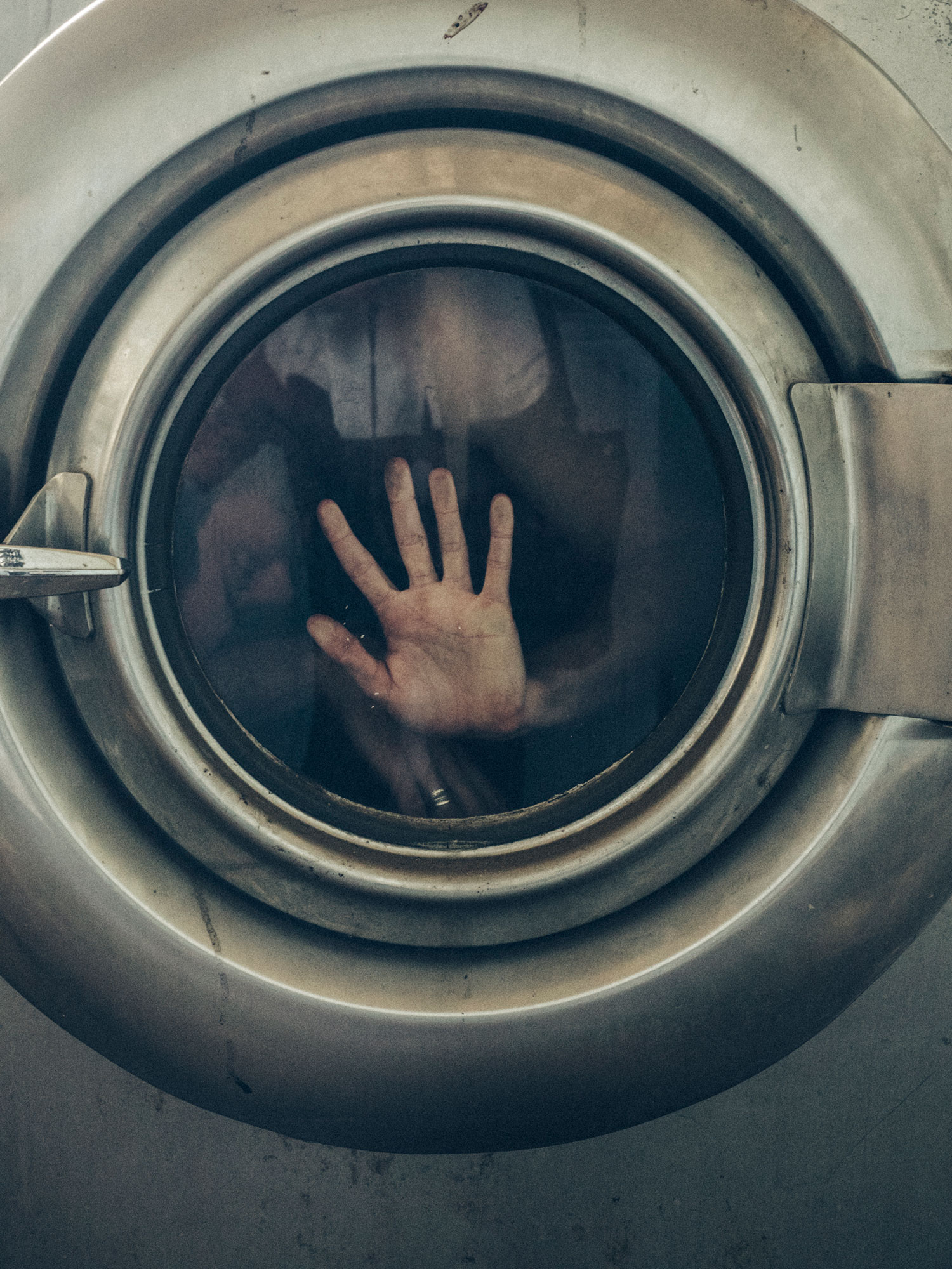 Denise Kwong - hand in laundry machine