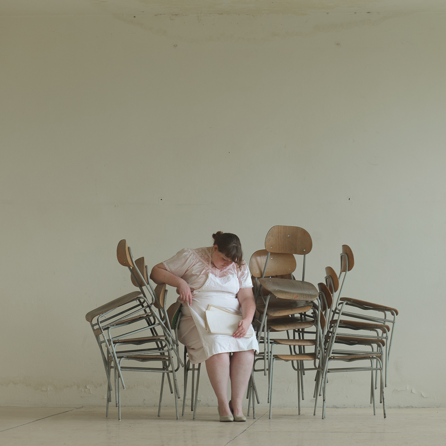 Evelyn Bencicova, School of Life - woman on stacked chairs
