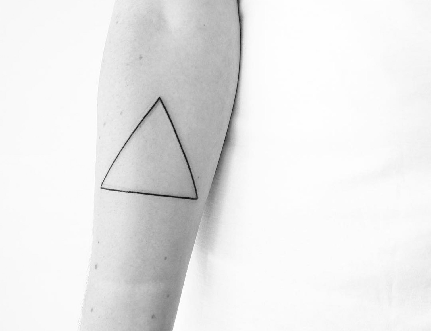 simple lined triangle tattoo