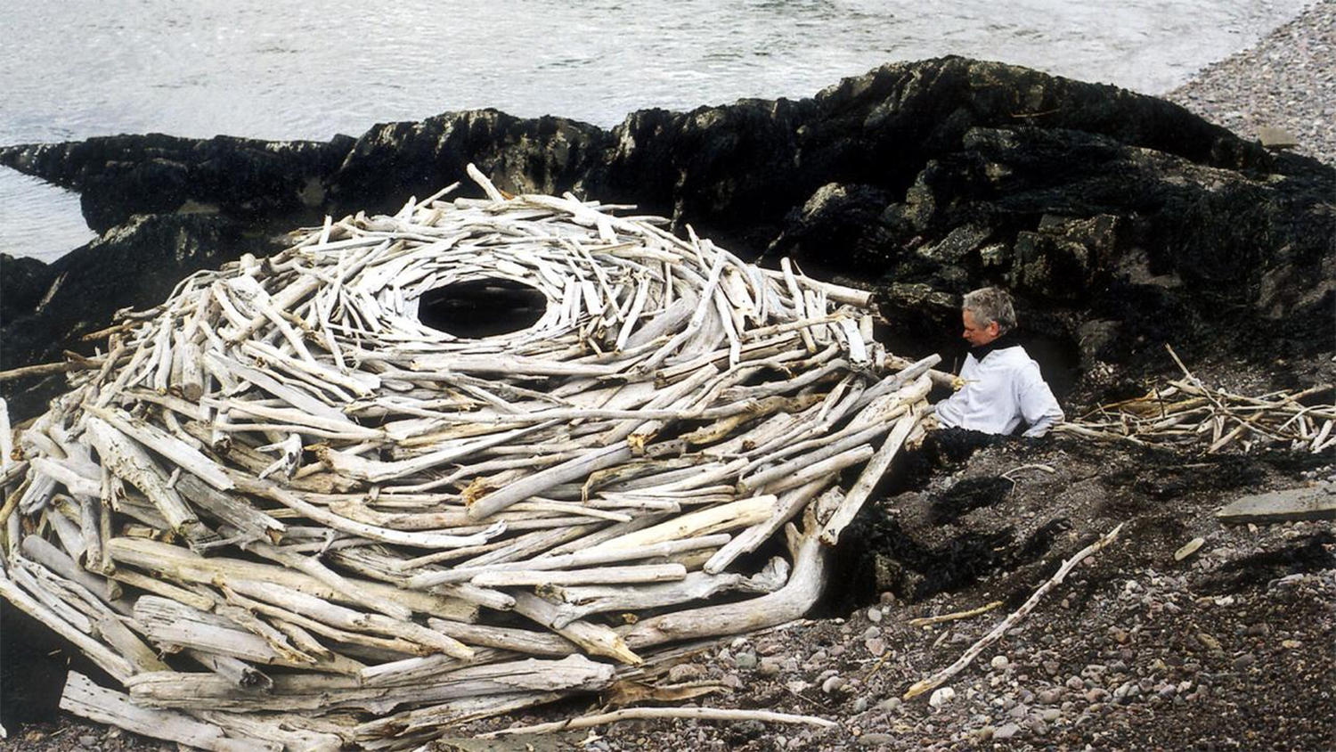 Andy Goldsworthy working on an environmental art piece