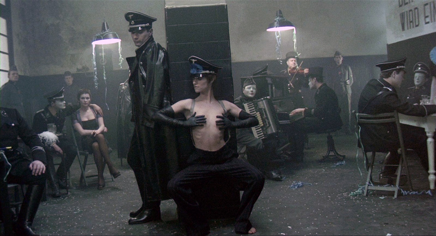 BDSM Movies - The Night Porter, woman in BDSM gear and soldiers