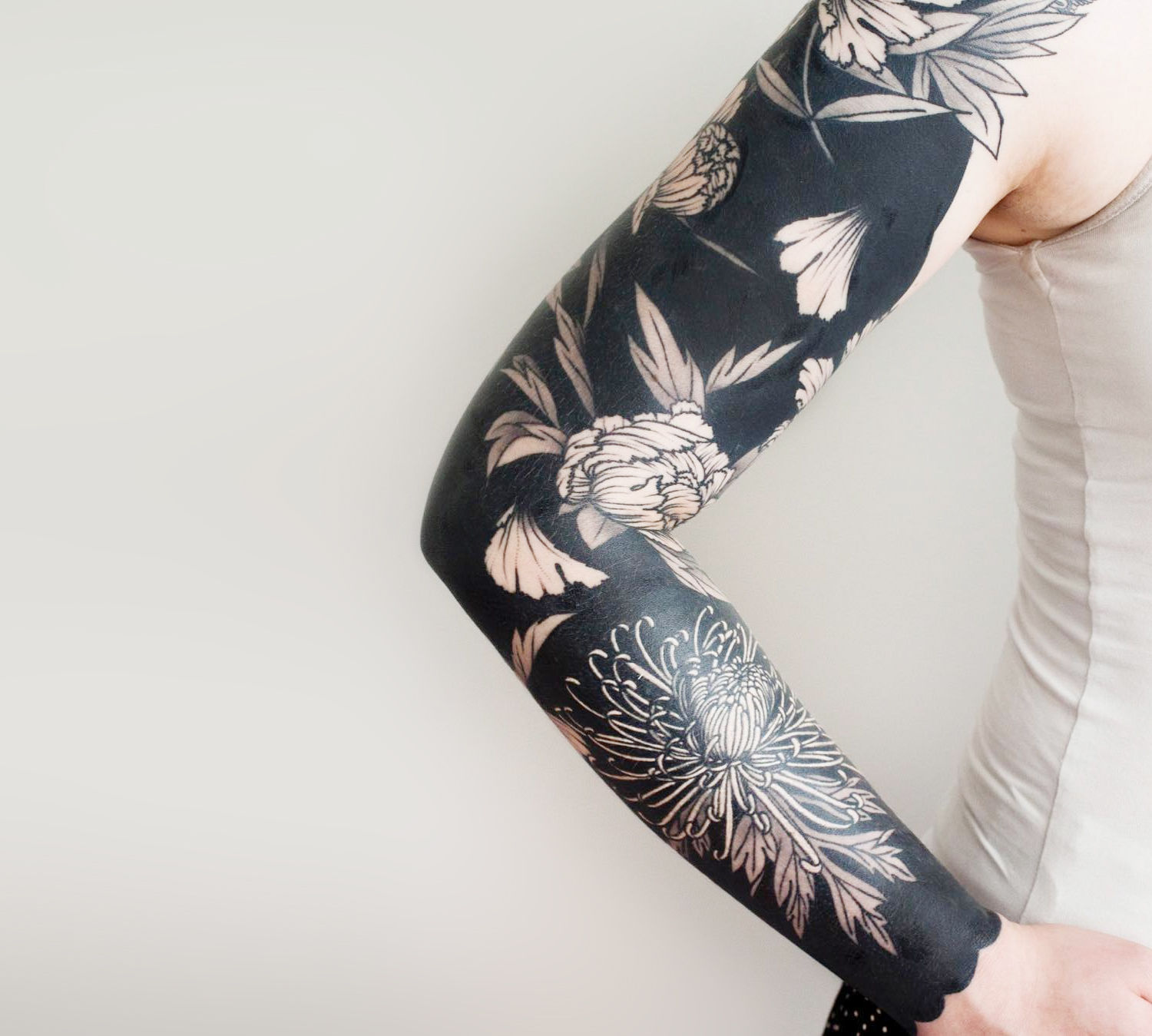 negative space flower tattoo sleeve by Josh Stephens