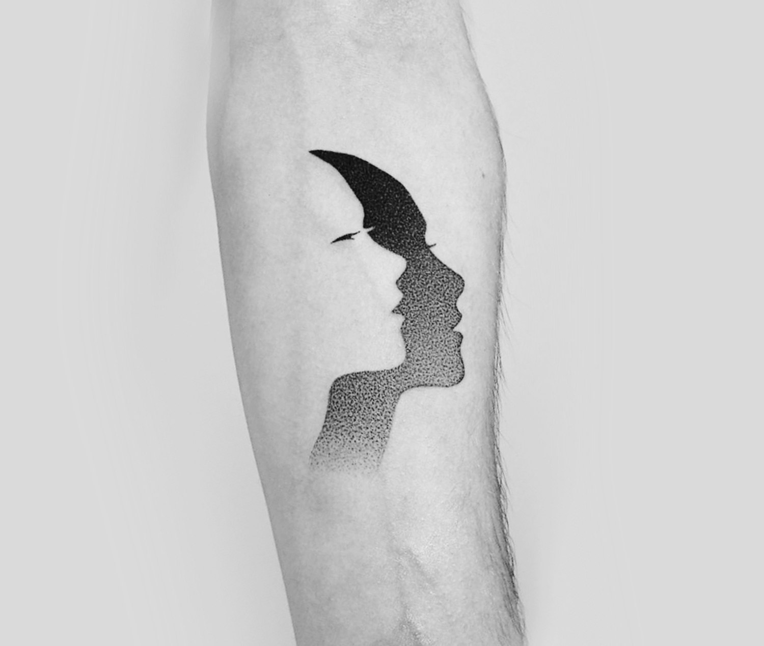 double face, negative space tattoo by Dotyk