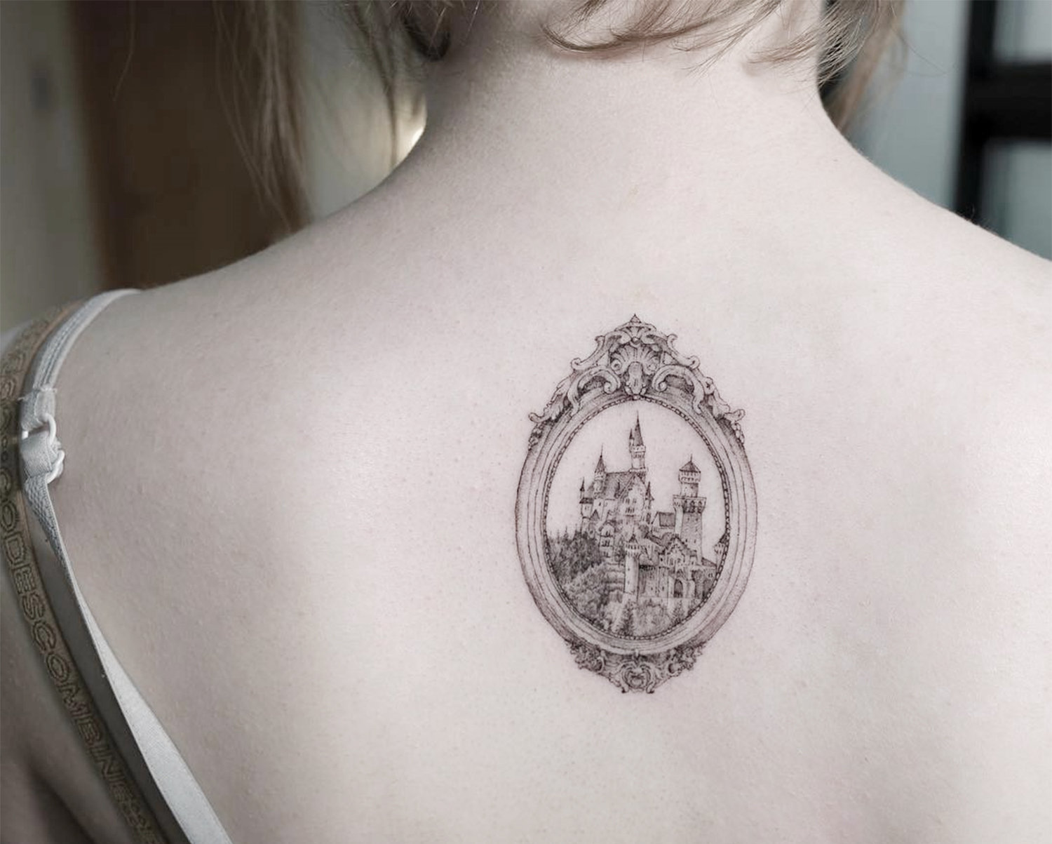 framed castle on back, tattoo by sol art