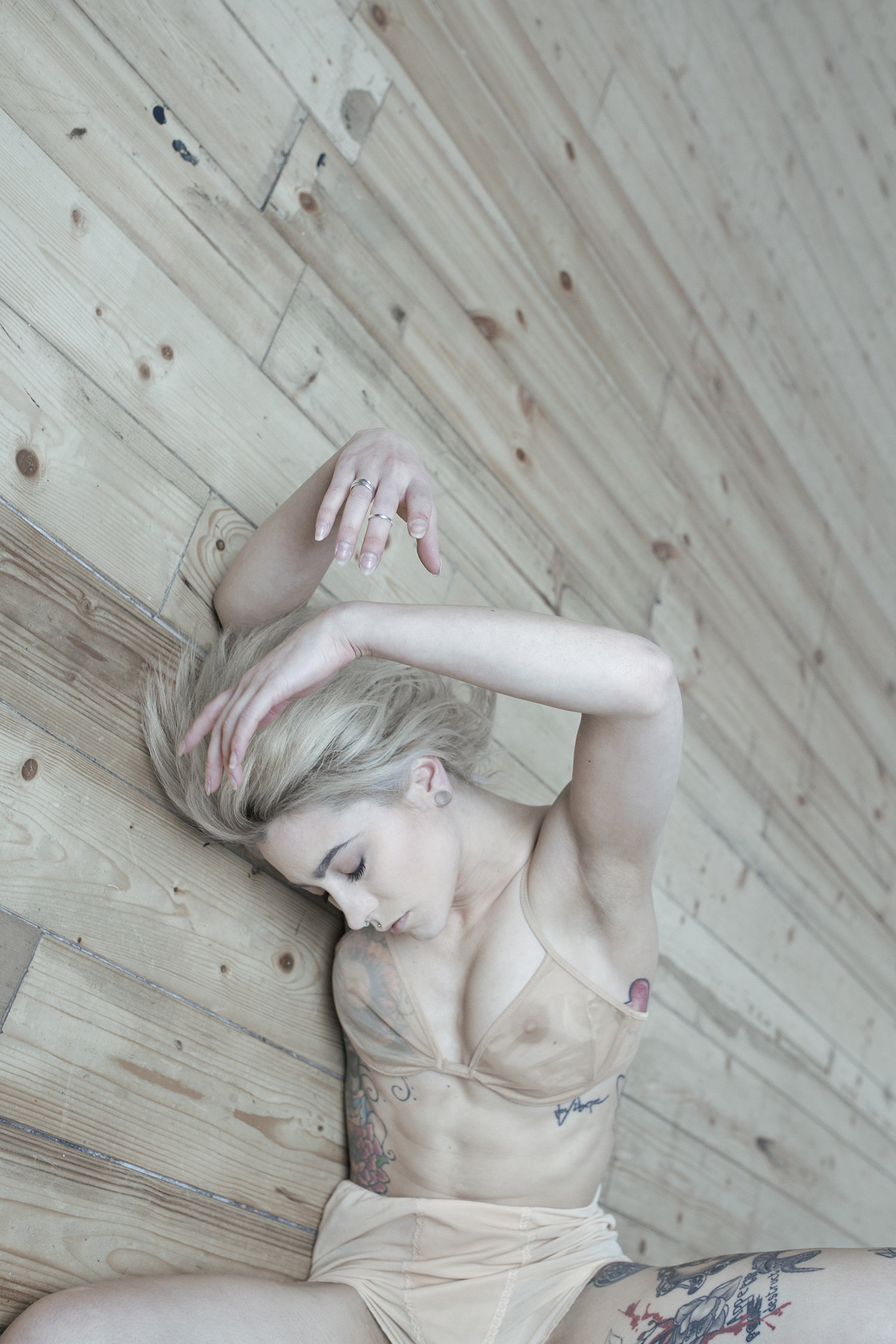woman and bra, lying on floor