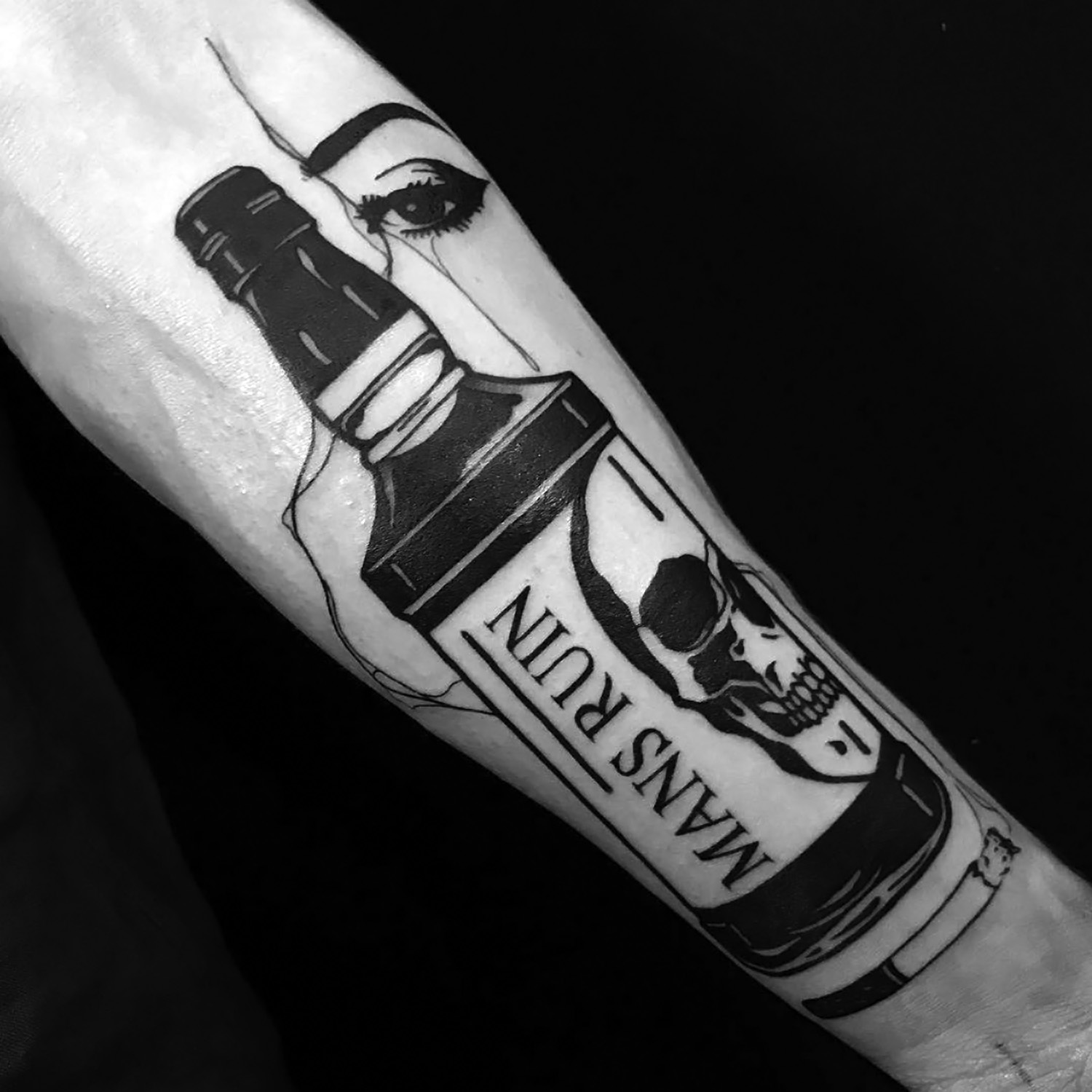 Louis Loveless tattoo smokey eyes behind bottle