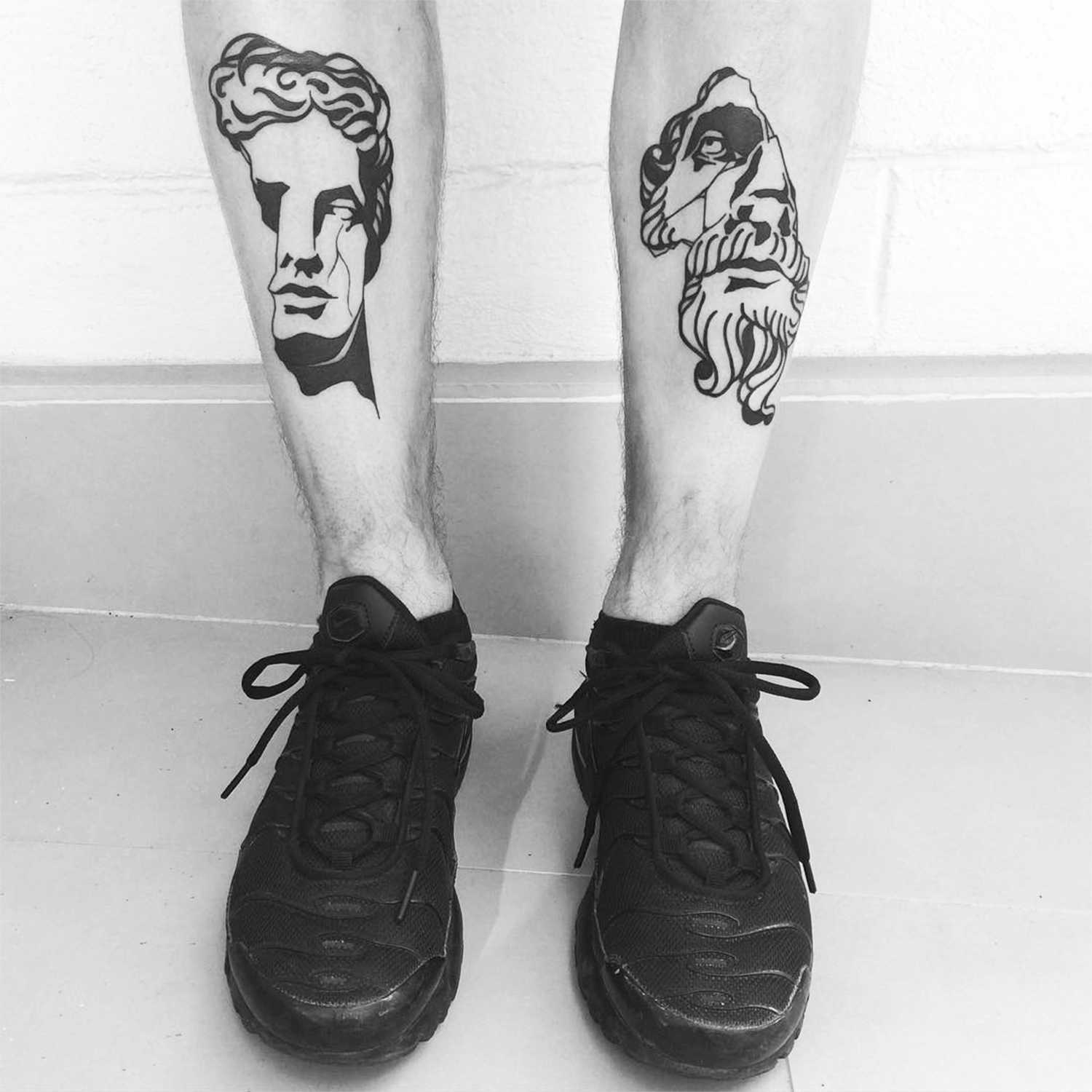 classical sculpture portrait tattoos on legs