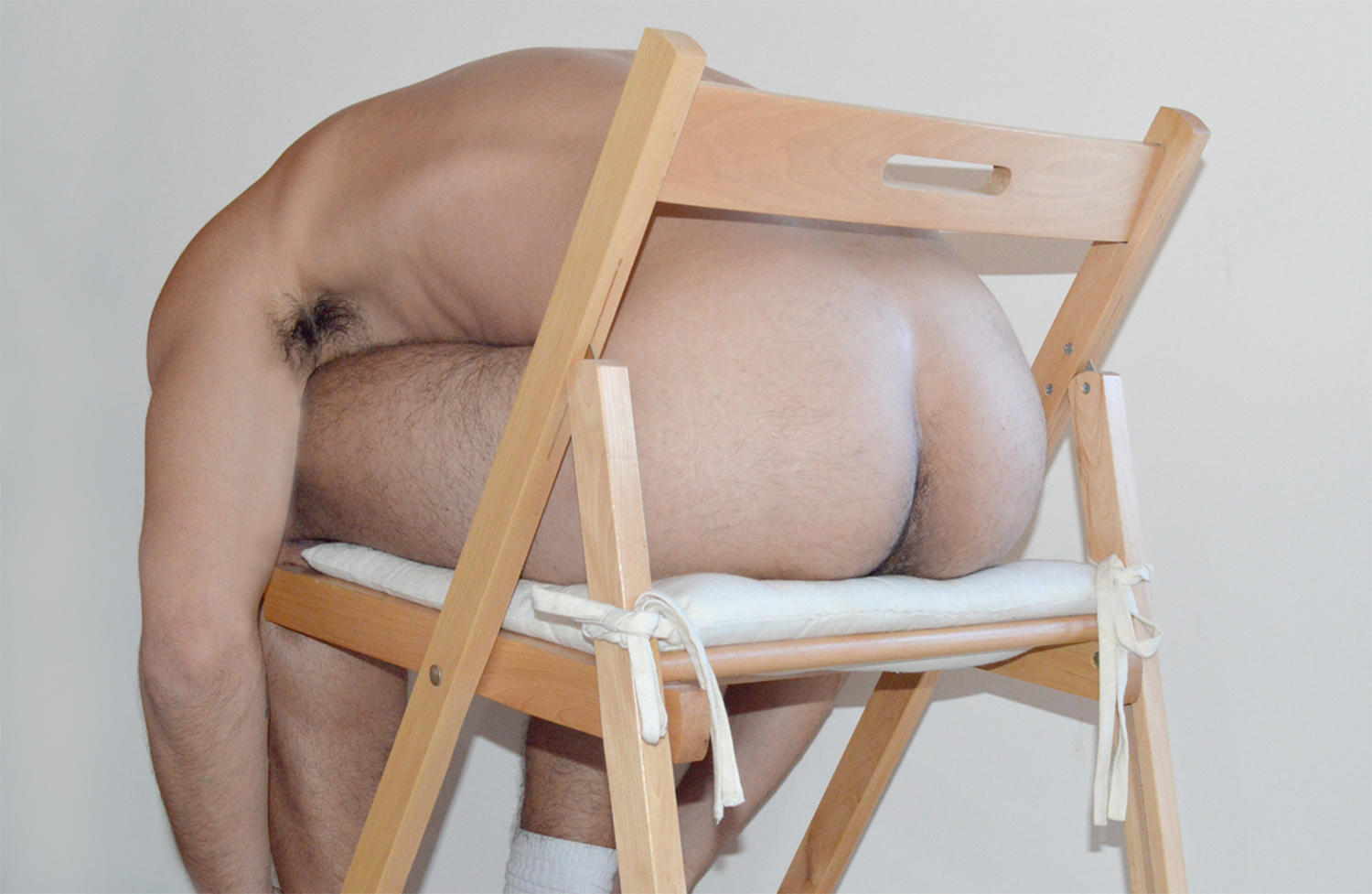 male nude, sitting on chair by kotis fokas