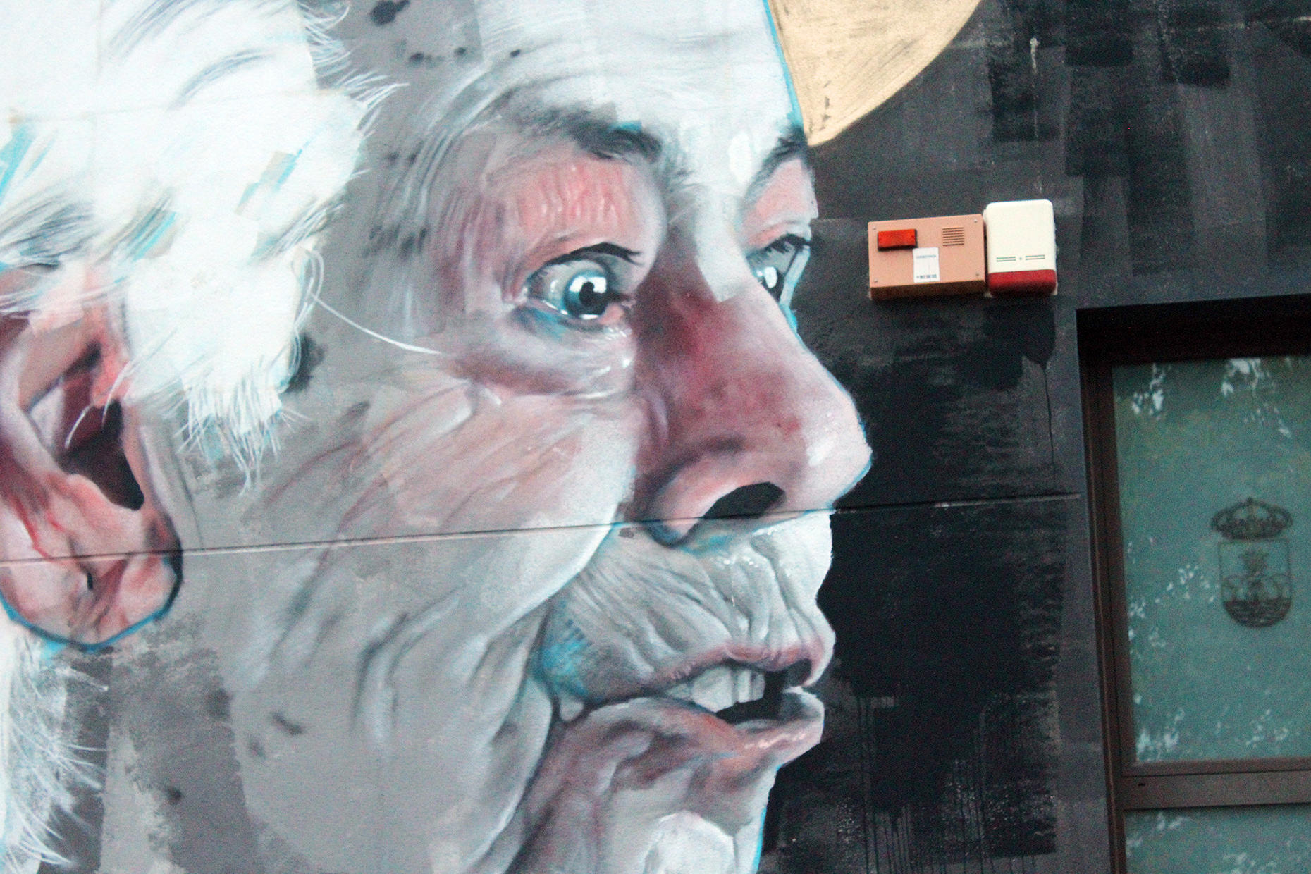 zoom of grandmother, wolf, street art