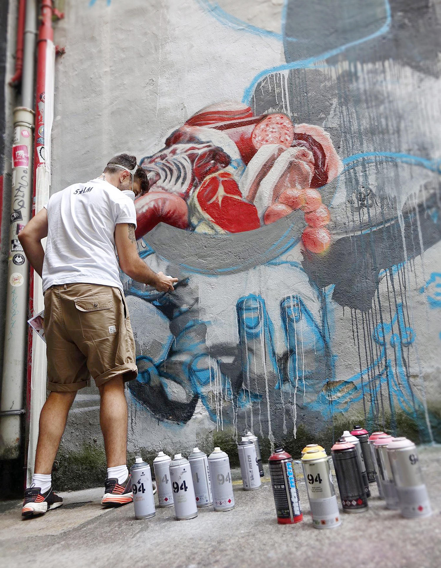 the artist spray painting, dan ferrer