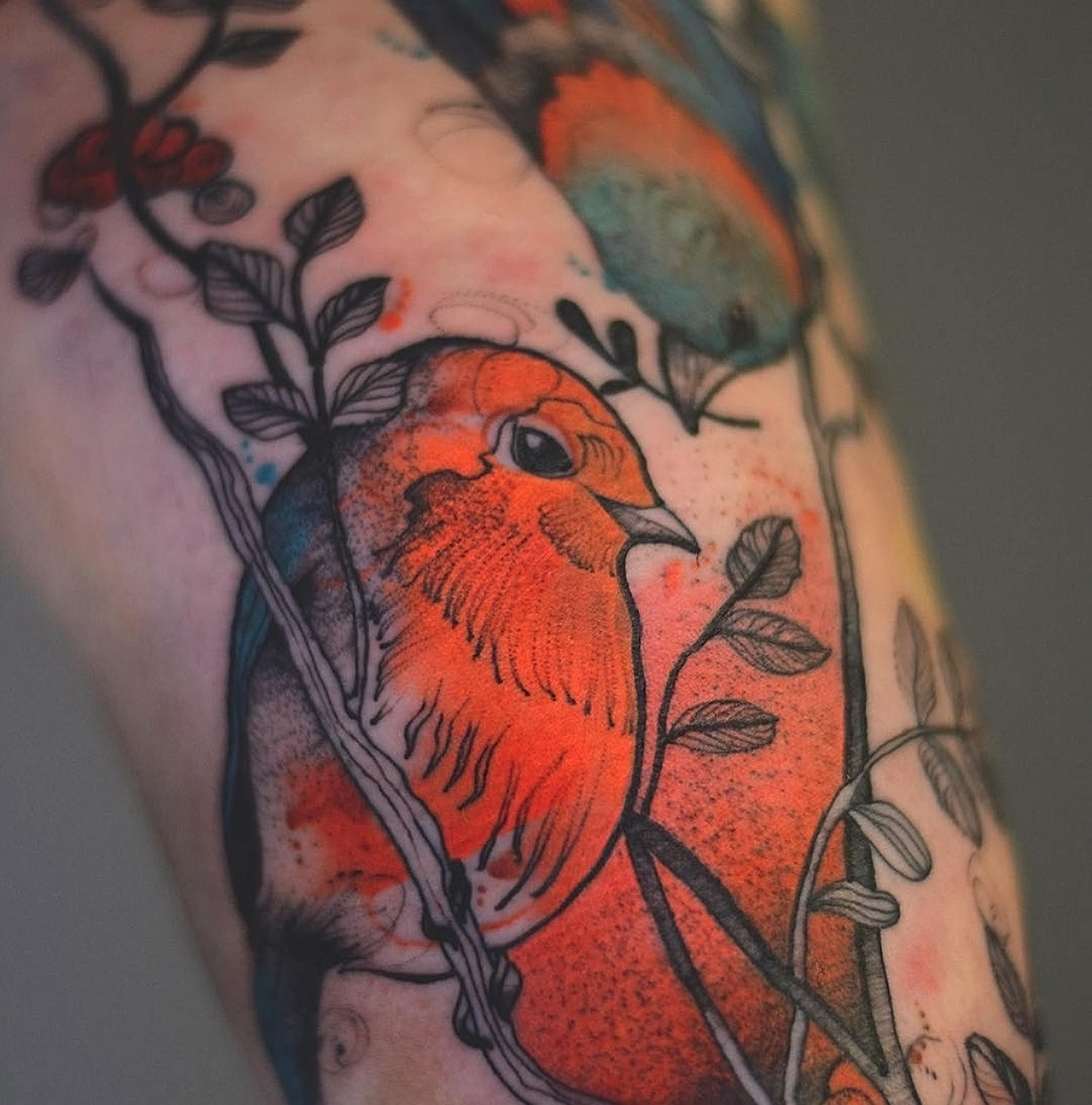 bird on a branch, red tattoo