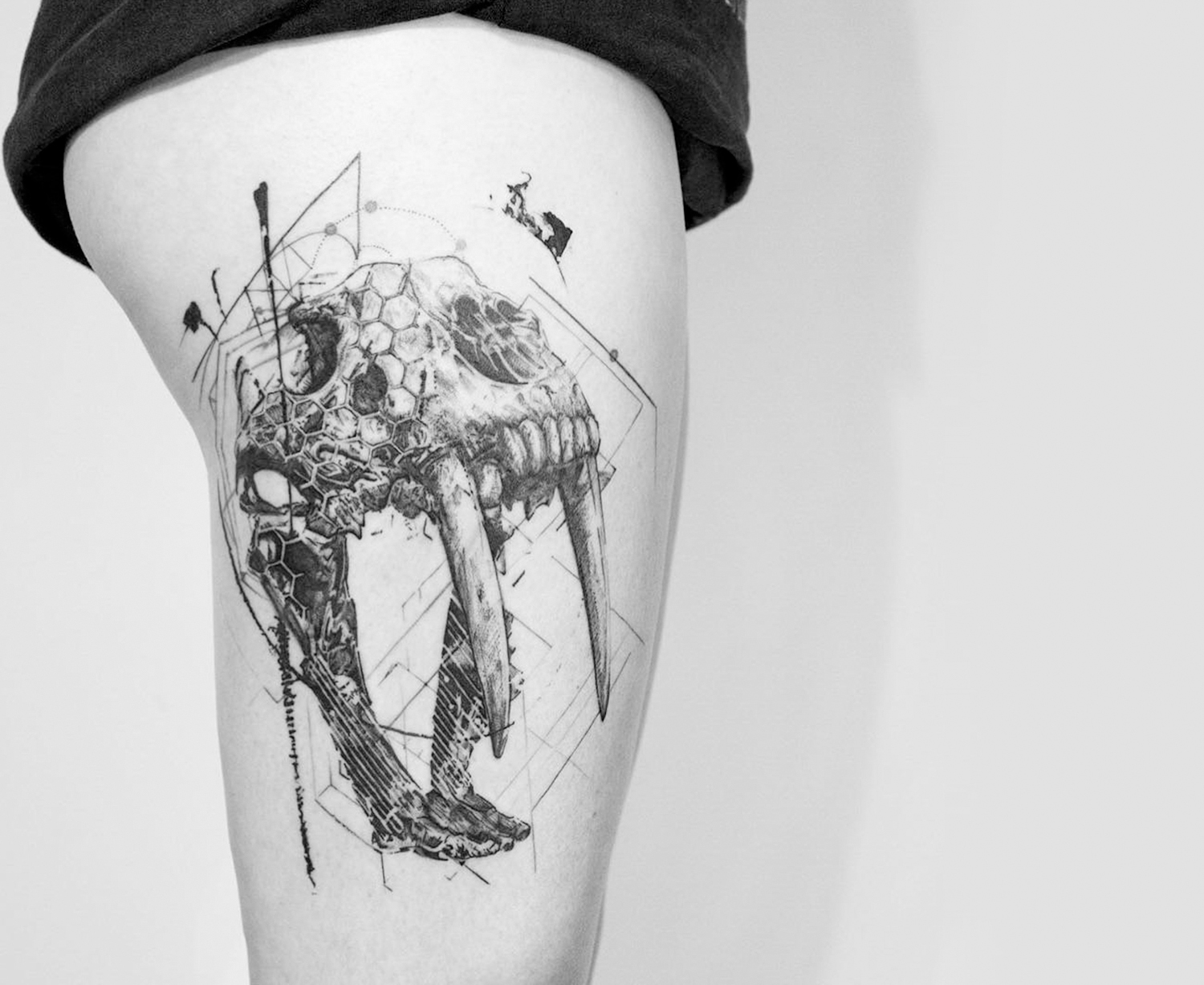 animal skull tattoo on thigh