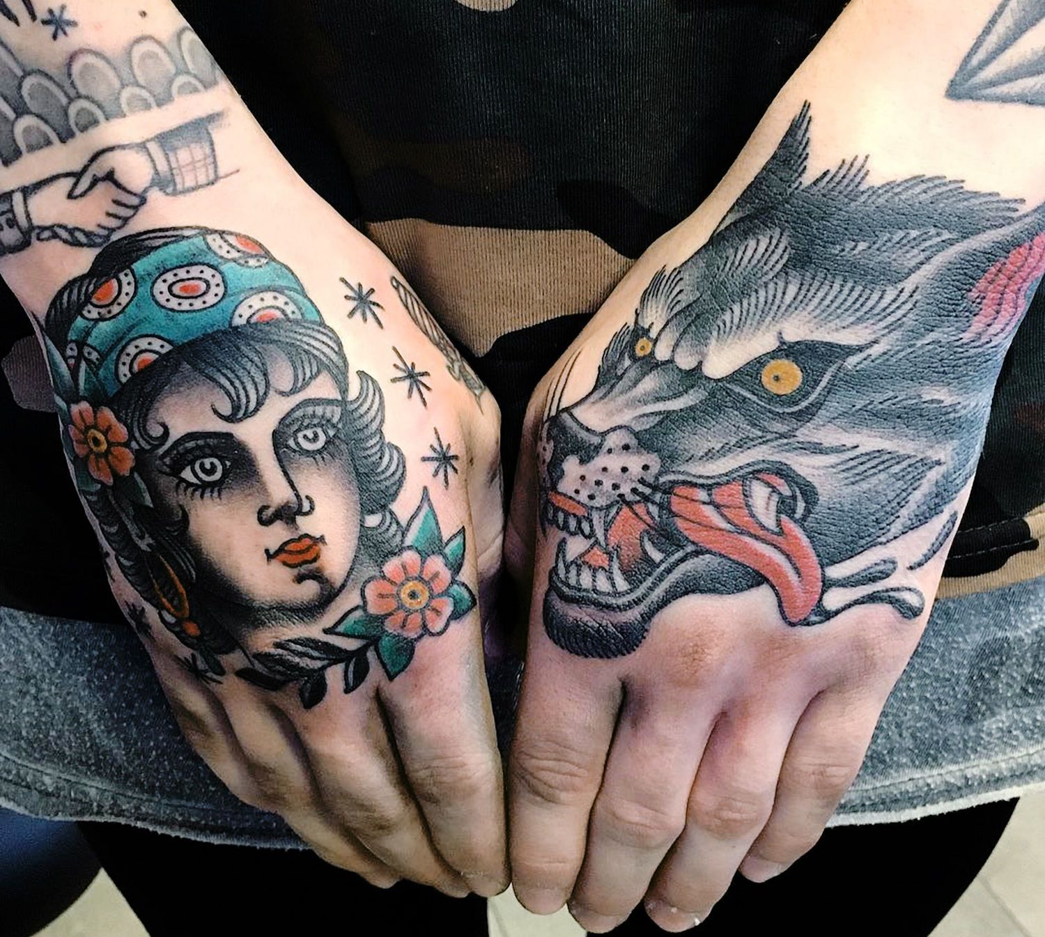 woman and wolf tattoo on hands