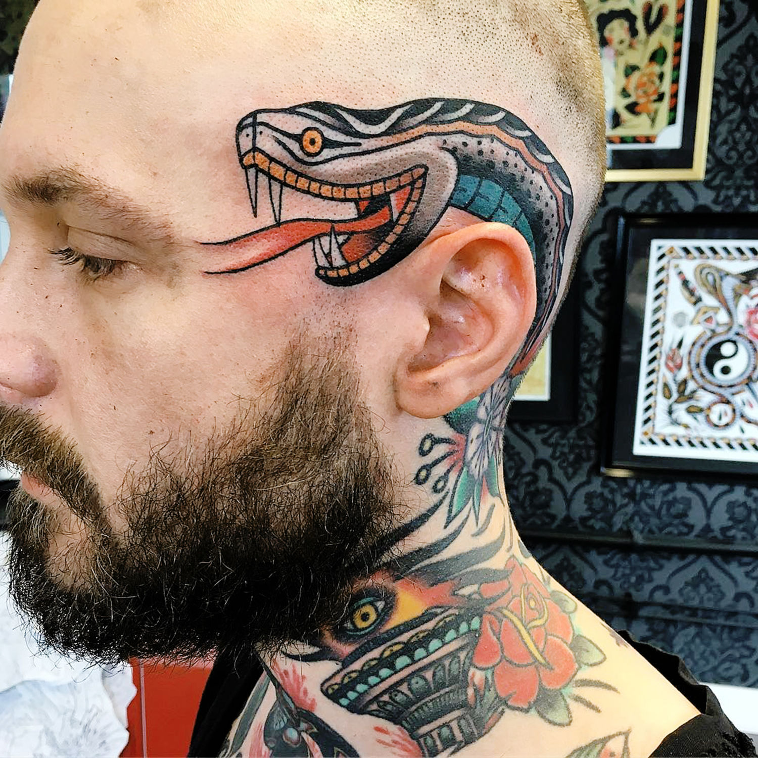 Snake tattoo on side of head, neotraditional