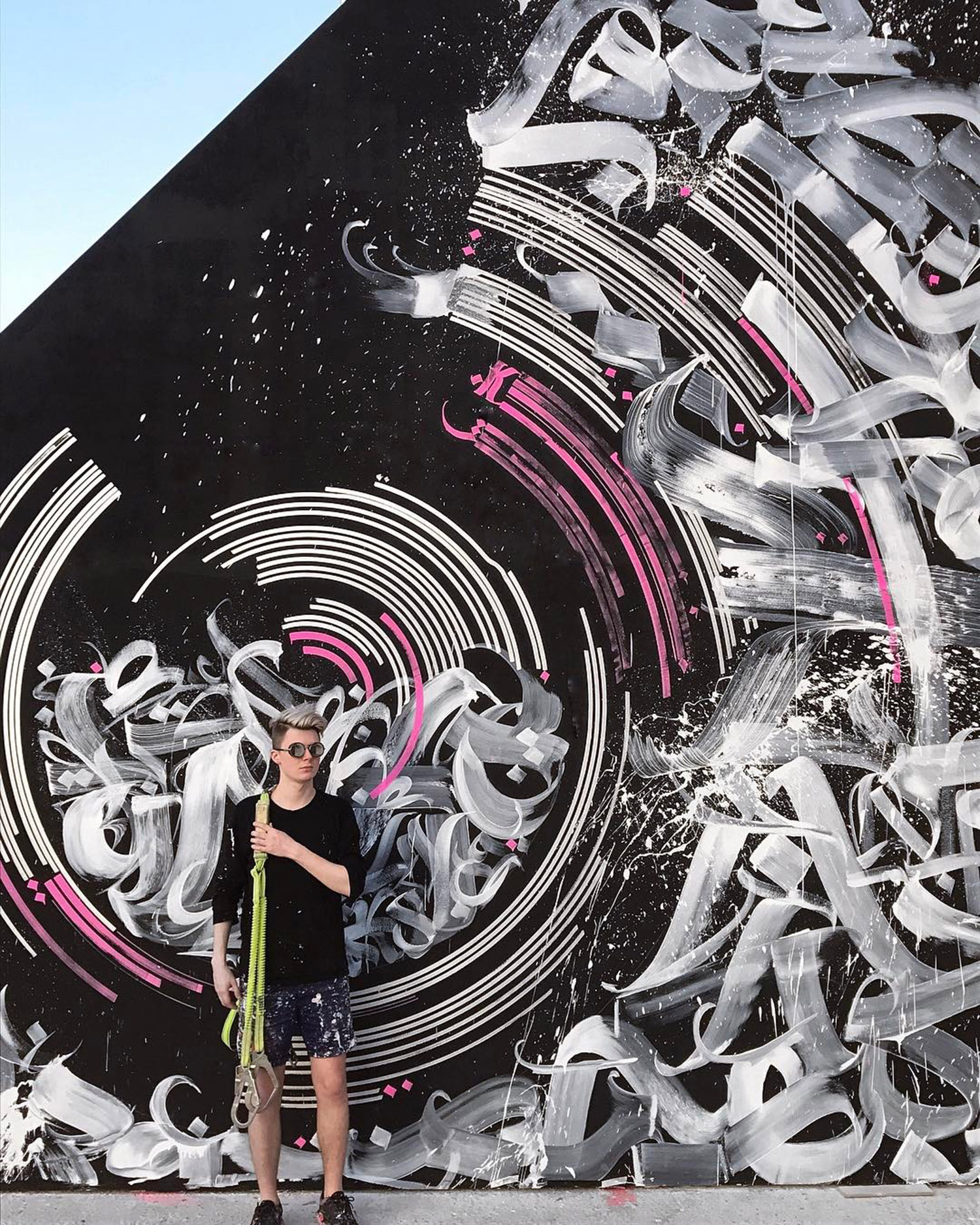 Pokras Lampas - portrait in front of mural