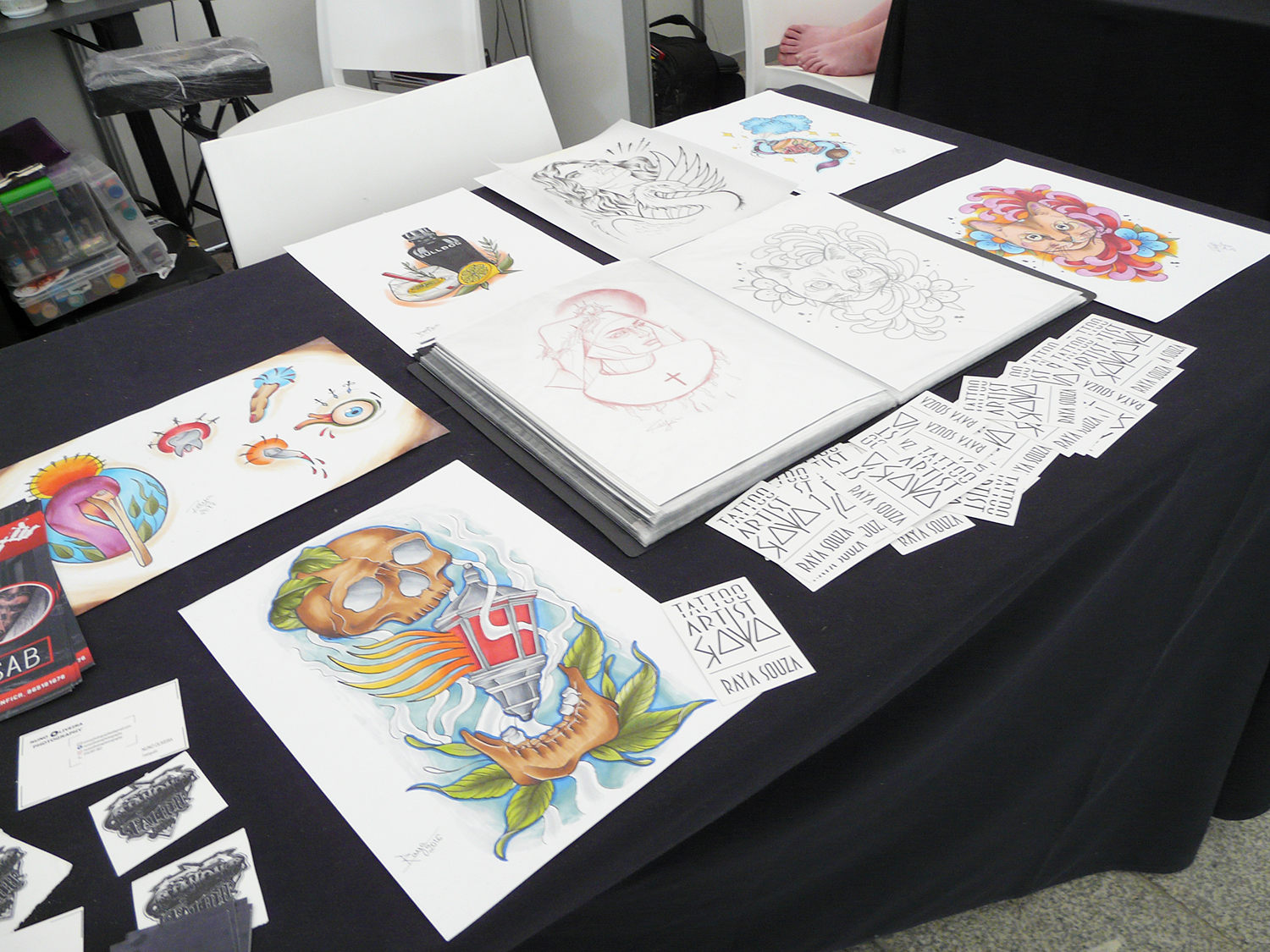 Raya Souza tattoo booth, flash art and stickers