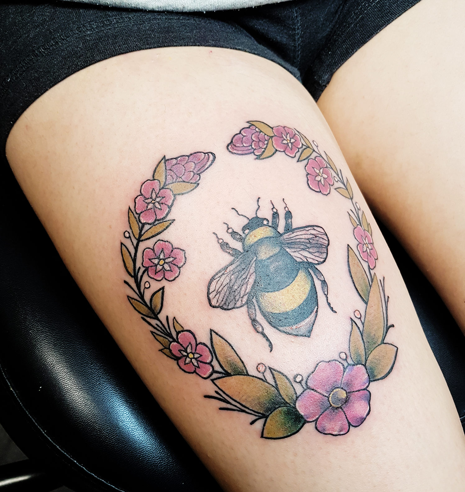 Bumblebee tattoo on leg